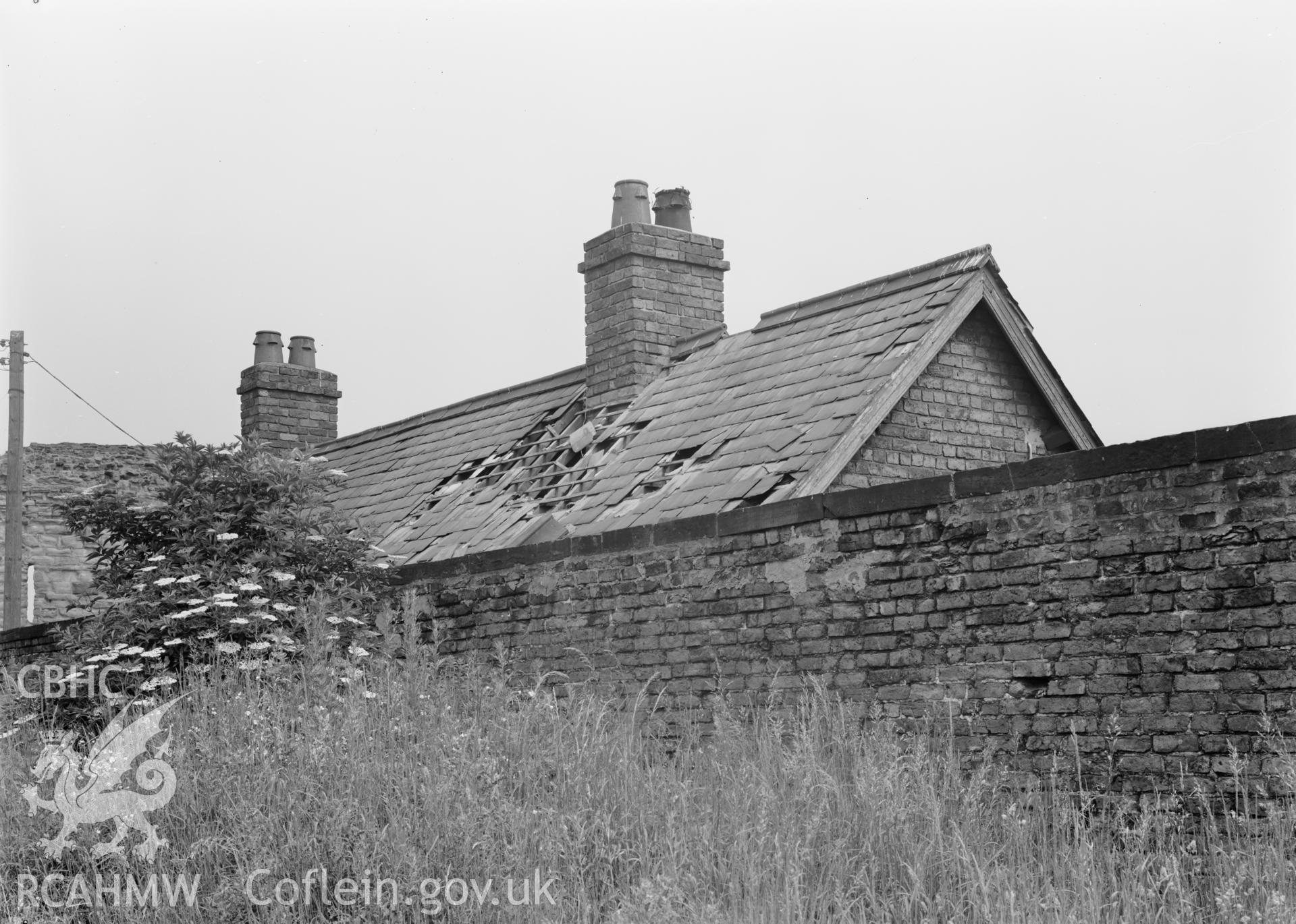 D.O.E photograph of Flint Gaol - damage to roof of cottage, from south.  In castle outer ward (since removed).