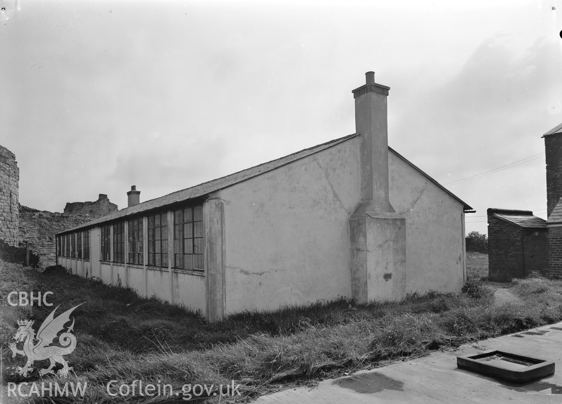 D.O.E photograph of Flint Gaol - army cadets hut from south west. In castle outer ward (since removed).