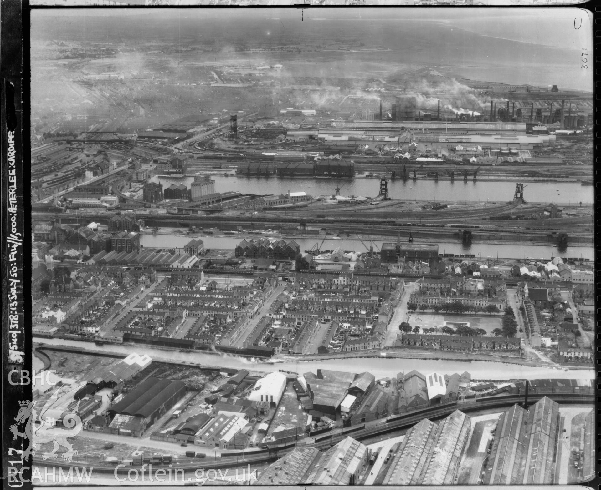 Black and white low level oblique aerial photograph taken by the RAF 1950 centred on Butetown, Cardiff .