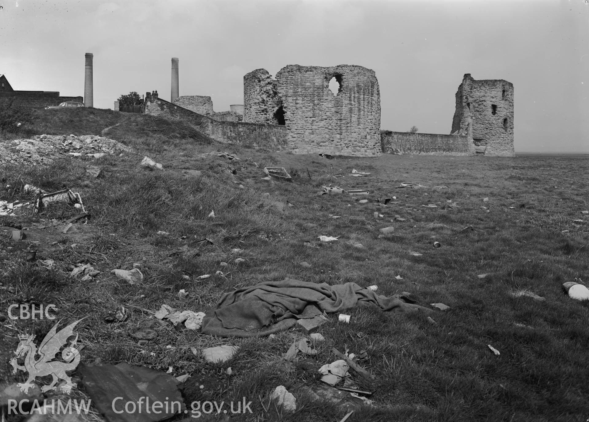 D.O.E photograph of Flint Gaol - view of castle from south east showing rubbish on bank and saltings. In castle outer ward (since removed).