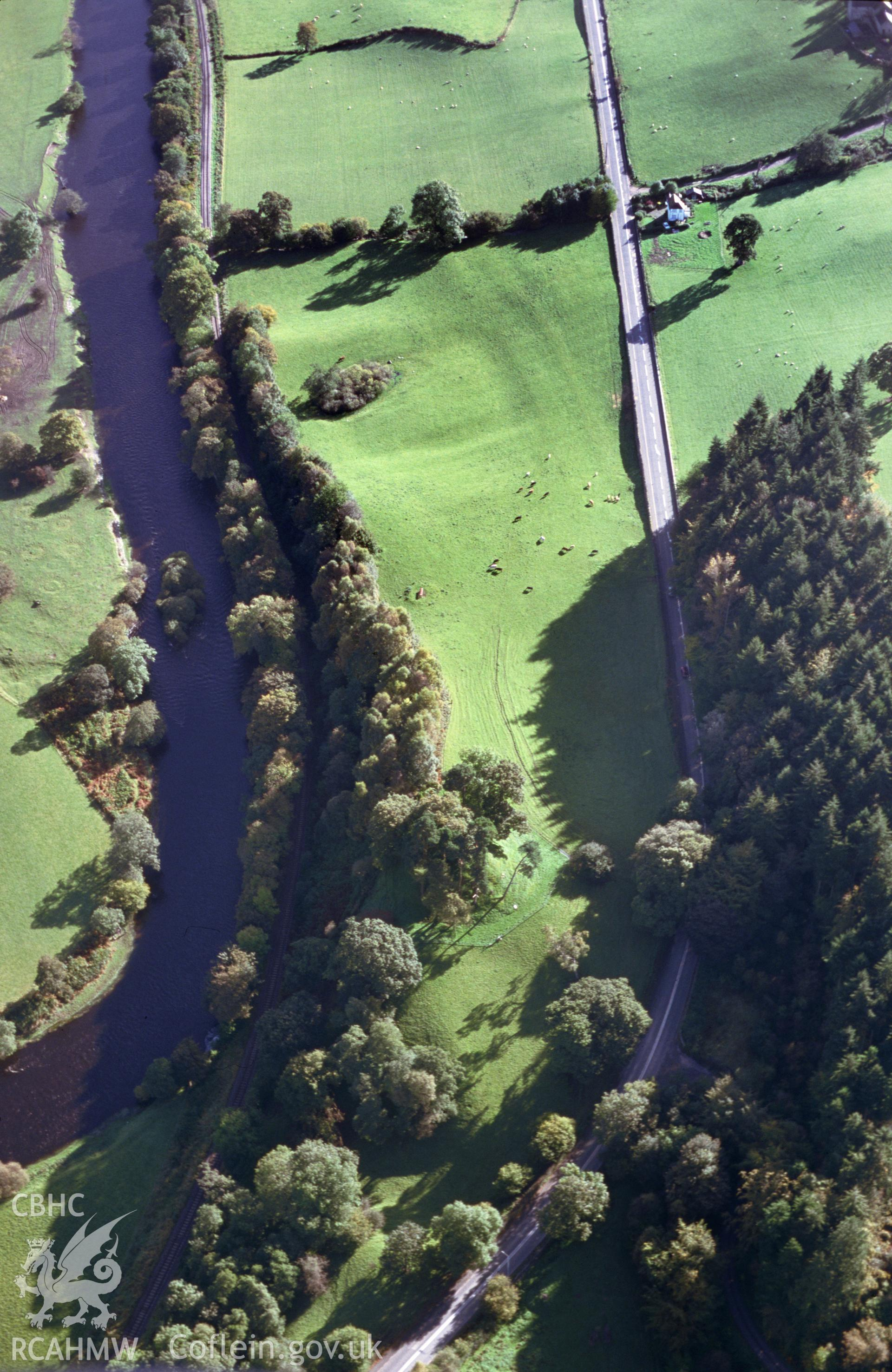 Slide of RCAHMW colour oblique aerial photograph of Owain Glyndwr's Mound, Motte, taken by T.G. Driver, 17/10/2000.
