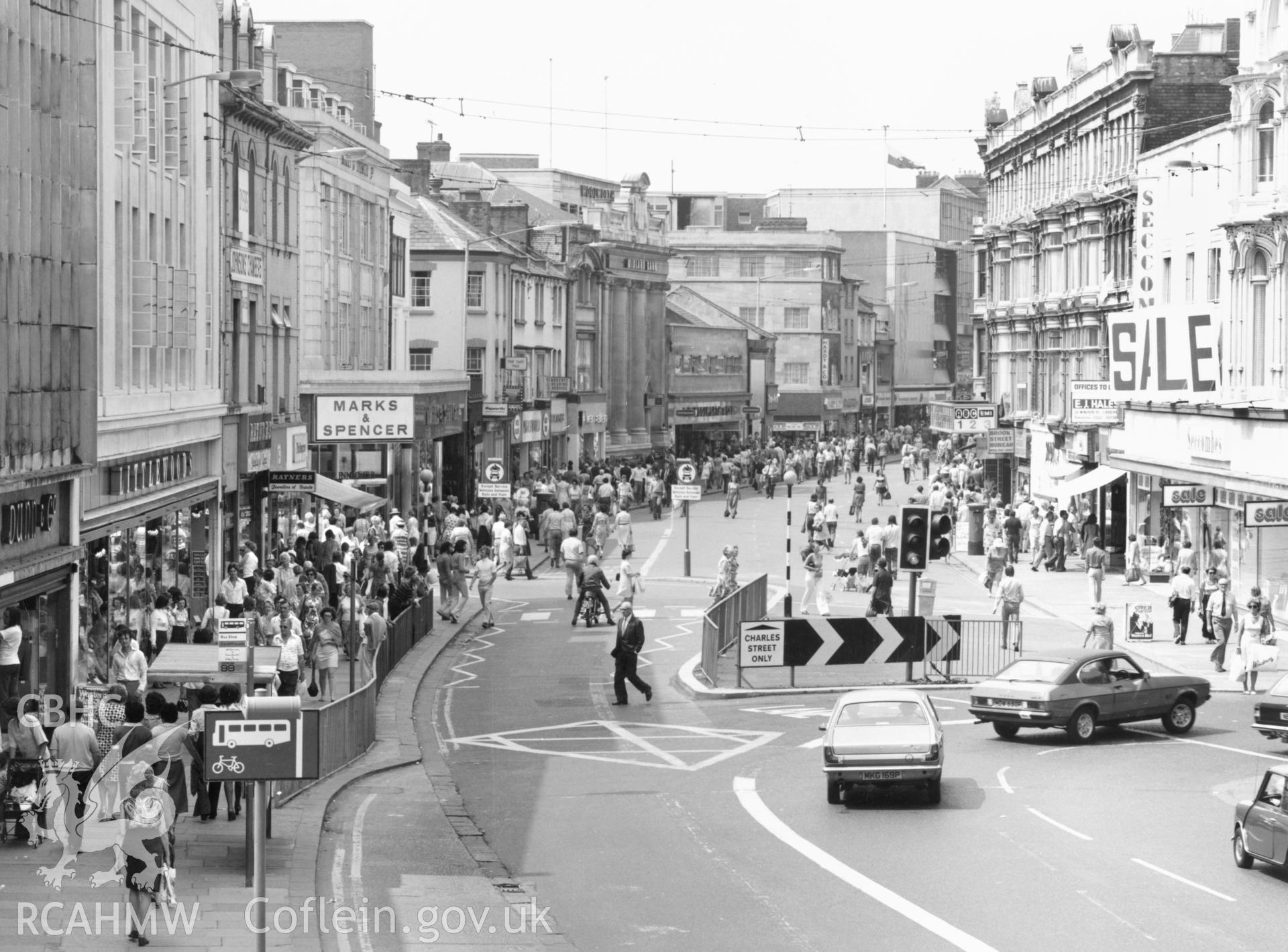 1 b/w print showing Queen Street, Cardiff, collated by the former Central Office of Information.