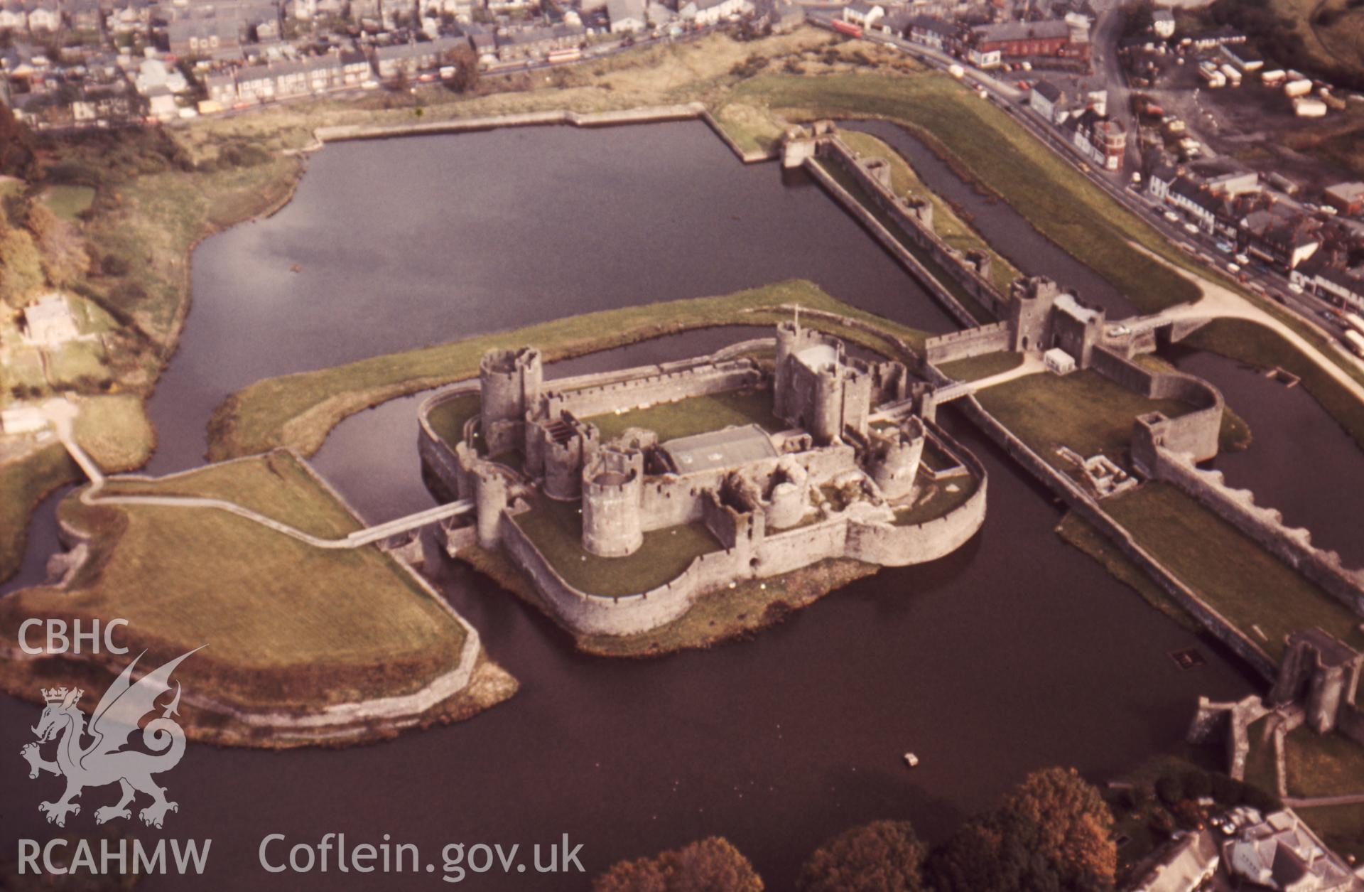 1 colour transparency showing aerial oblique view of Caerphilly Castle, undated; collated by the former Central Office of Information.