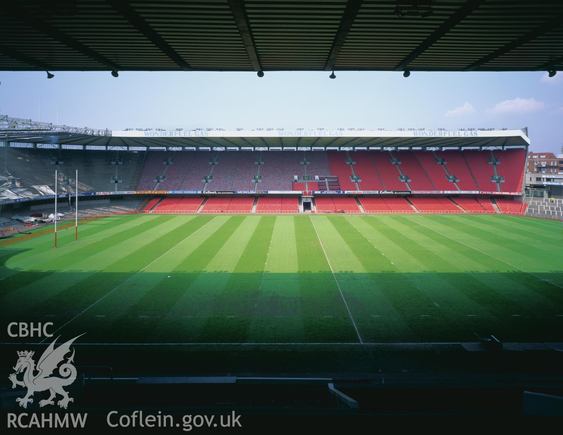 Colour transparency showing a view of the pitch and seating at Cardiff Arms Park, produced by Iain Wright 1997