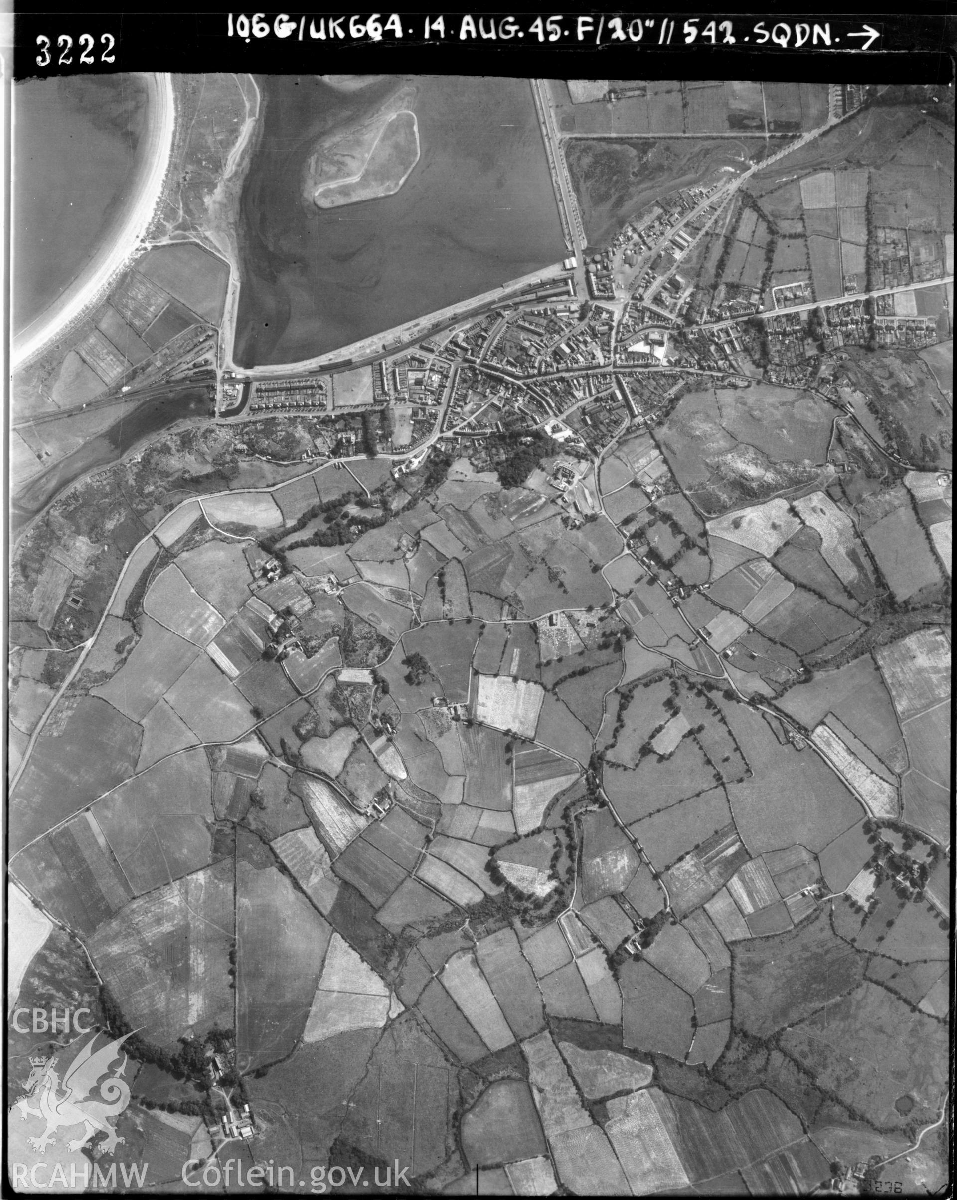 Black and white vertical aerial photograph taken by the RAF on 14/08/1945 centred on SH37583582 at a scale of 1:10000. The photograph includes part of Pwllheli community in Gwynedd.
