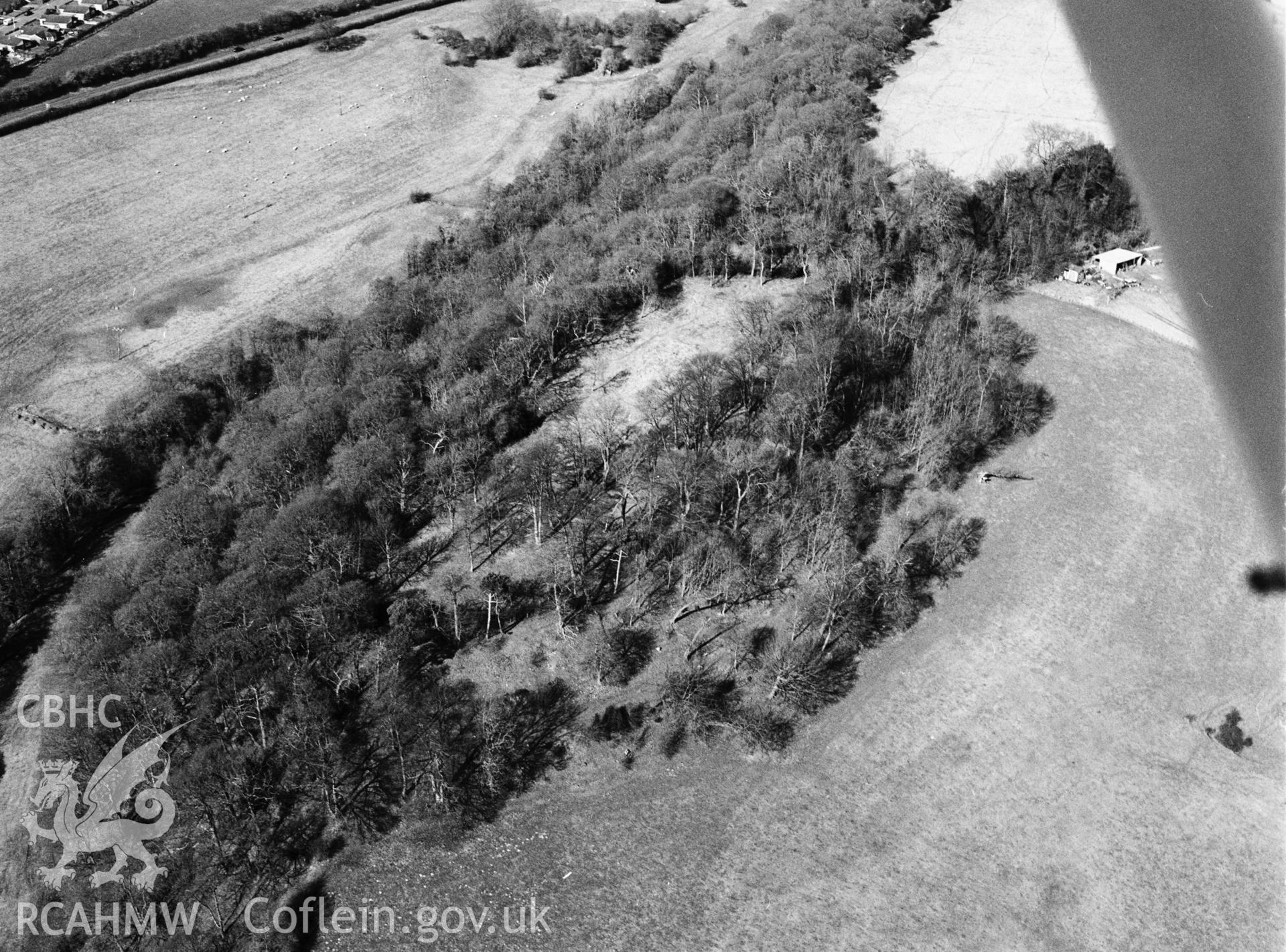 RCAHMW black and white oblique aerial photograph of Bryn Alyn Camp, hillfort. Taken by Toby Driver on 14/03/2003