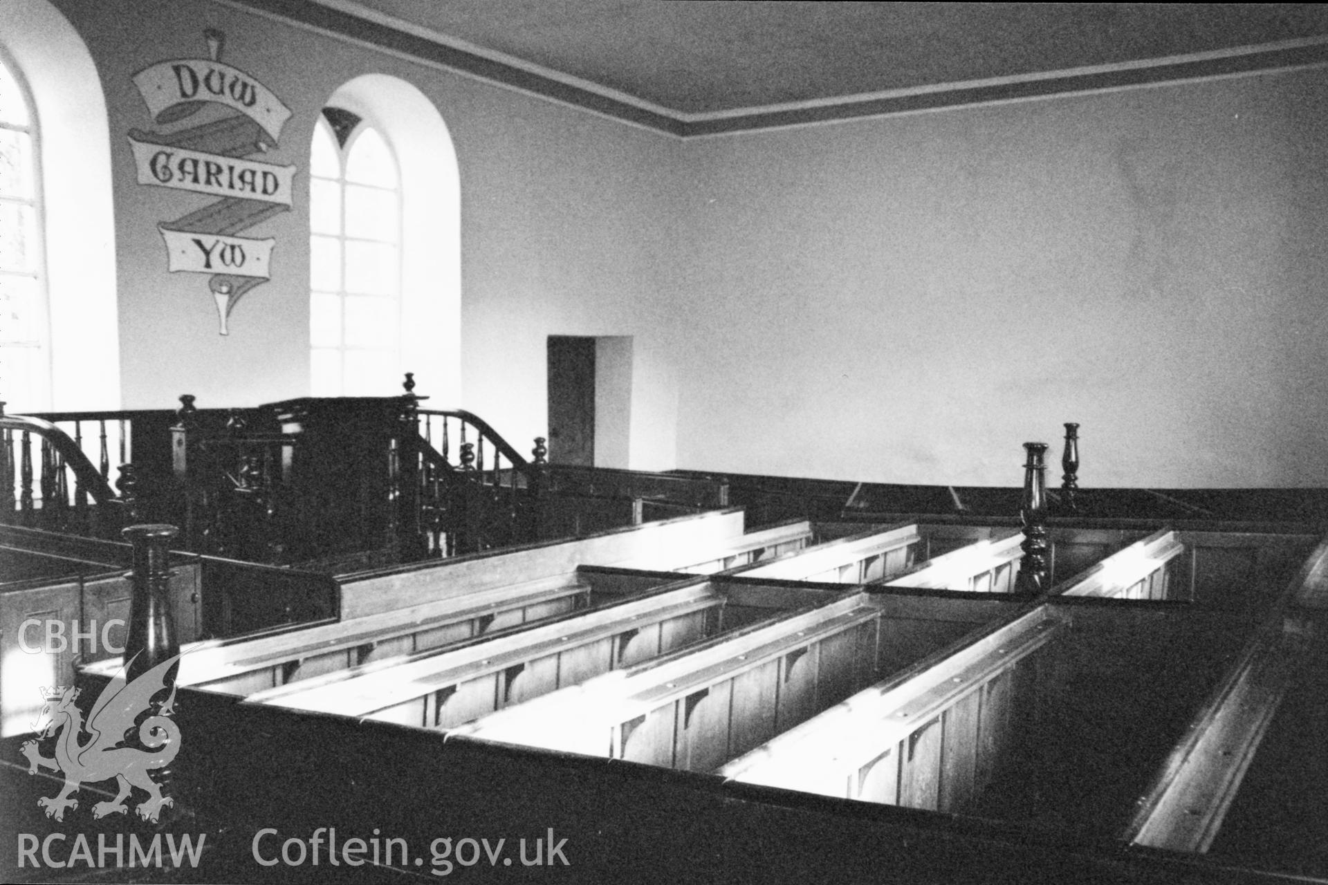Digital copy of a black and white photograph showing an interior view of Soar-y-Mynydd  Welsh Calvinistic Methodist Chapel, Llanddewi Brefi, taken by Robert Scourfield, 1996.