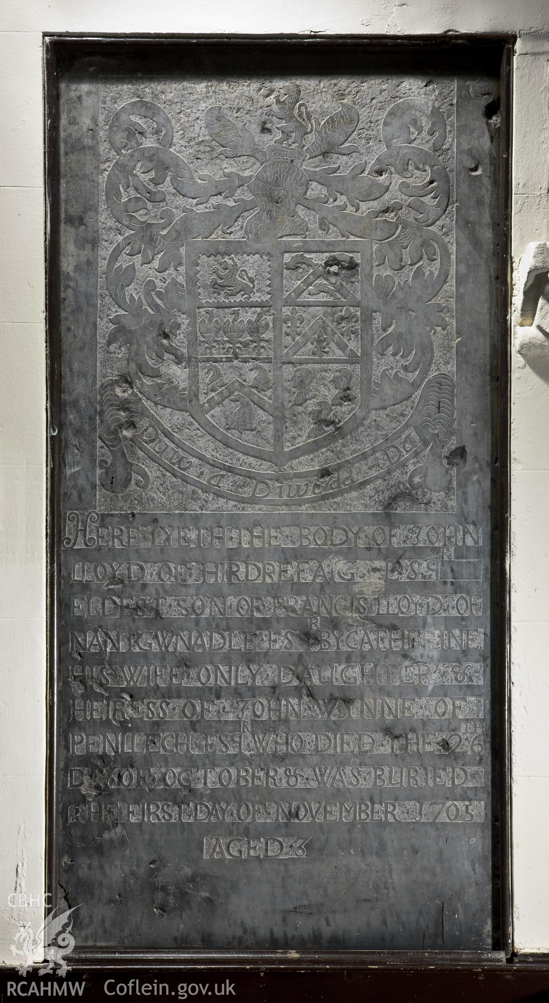 Carved slate memorial slab on southeast wall.