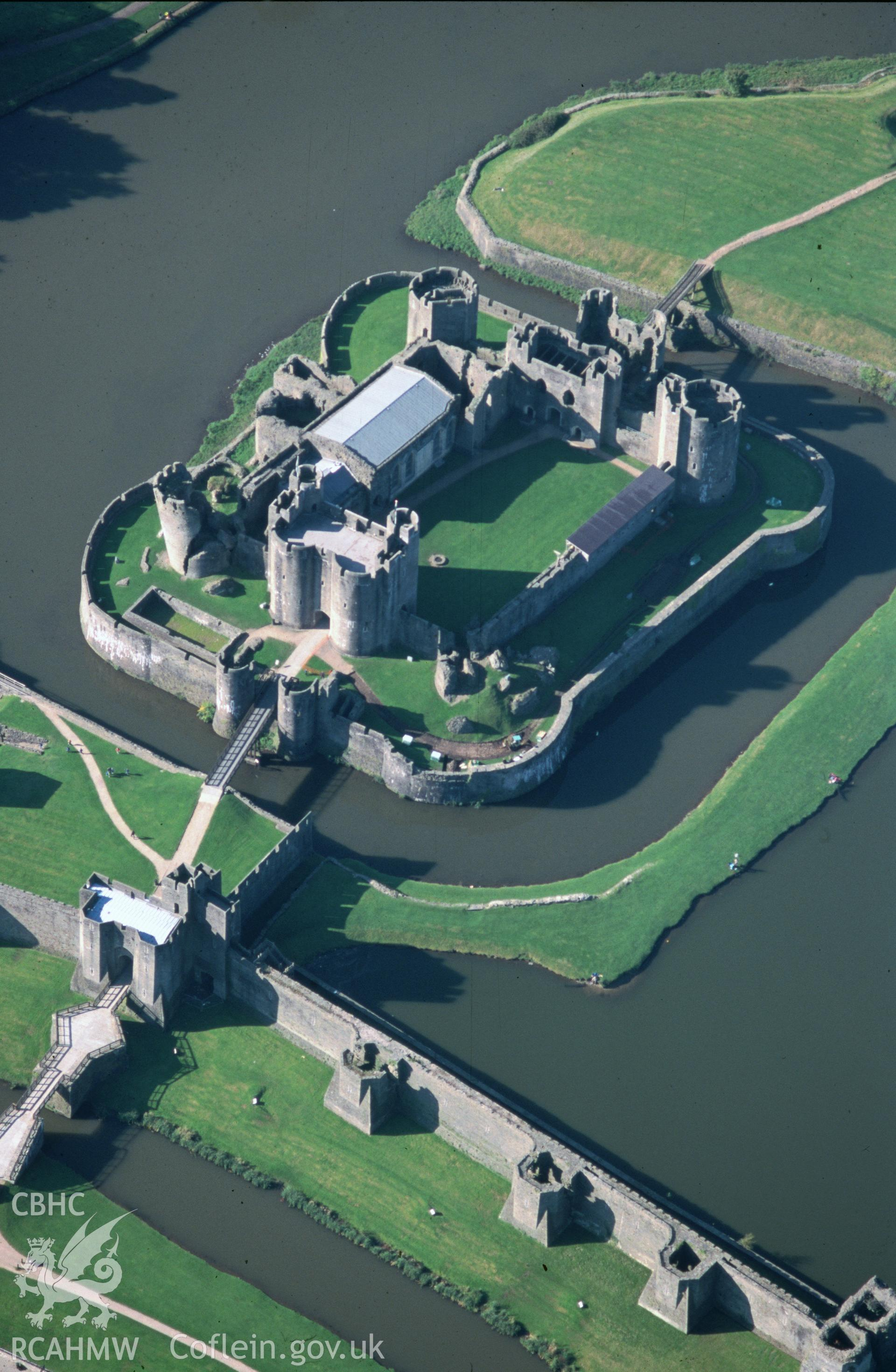 Slide of RCAHMW colour oblique aerial photograph of Caerphilly Castle, taken by T.G. Driver, 13/10/1999.