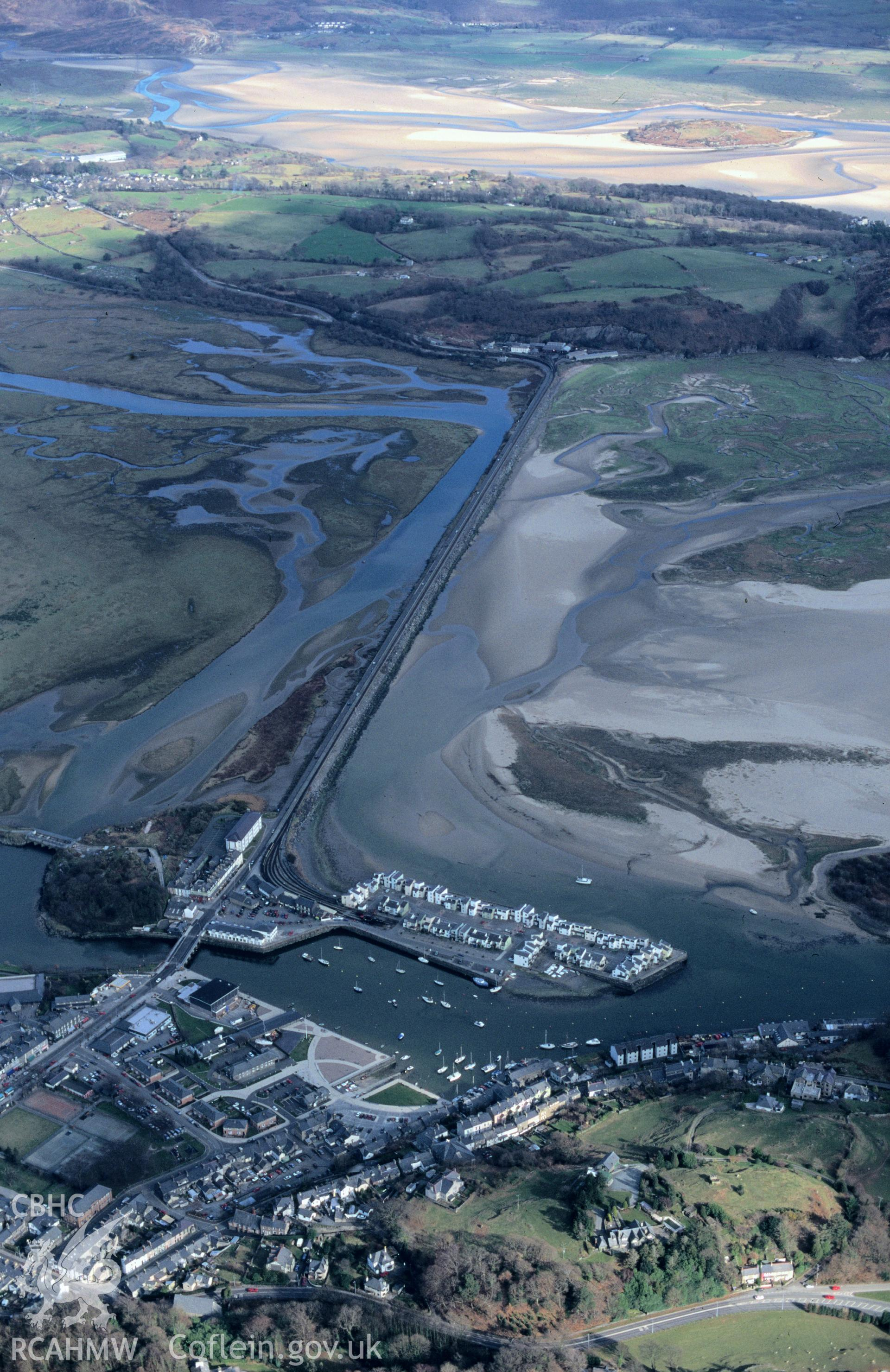 RCAHMW colour slide oblique aerial photograph of Traeth Mawr Embankment, Porthmadoc;Penrhyndeudraeth, taken by C.R.Musson on the 30/03/1996
