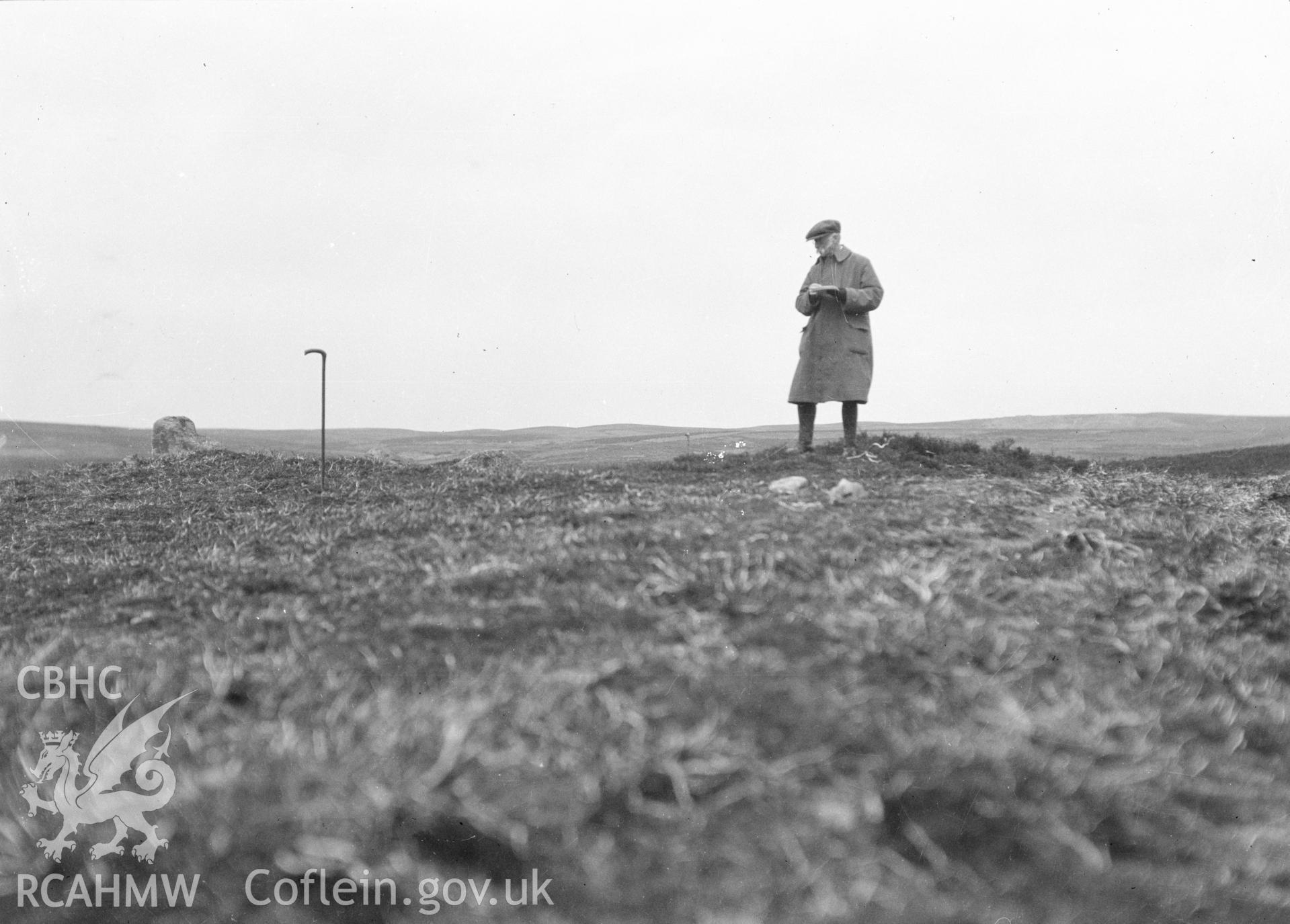 Digital copy of a nitrate negative showing Bryn Beddau round barrows. Back of negative copy dates the photograph to 'July 1930.' From the Cadw Monuments in Care Collection.