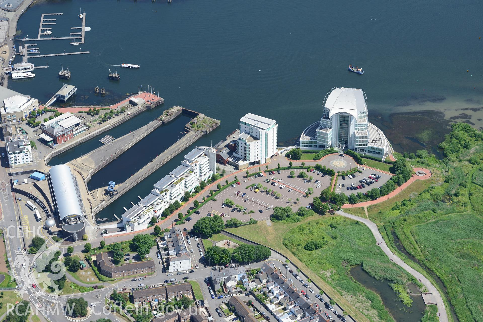 Techniquest and the St. David's Hotel, Cardiff Bay. Oblique aerial photograph taken during the Royal Commission's programme of archaeological aerial reconnaissance by Toby Driver on 29th June 2015.