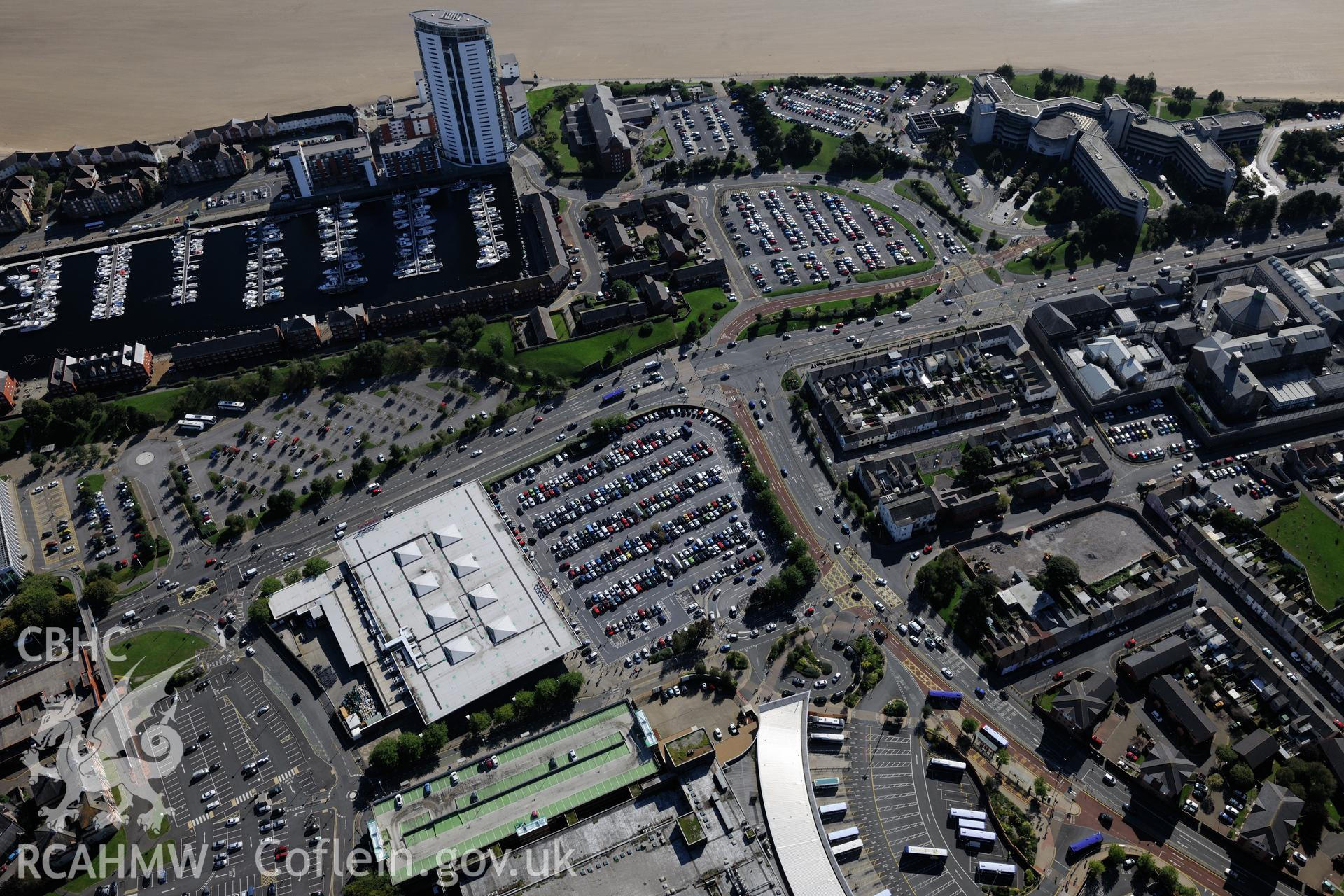 South Dock and Meridian Quay development, Swansea. Oblique aerial photograph taken during the Royal Commission's programme of archaeological aerial reconnaissance by Toby Driver on 30th September 2015.