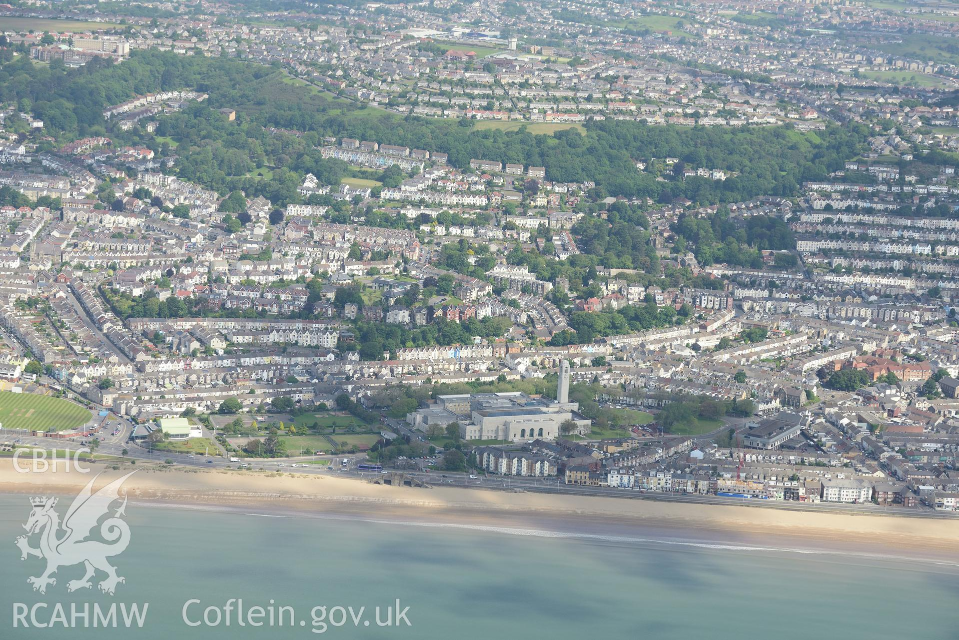 Guildhall, Victoria Park, Patti Pavilion and St. Helen's Cricket and Rugby Ground, taken from Swansea Bay. Oblique aerial photograph taken during the Royal Commission's programme of archaeological aerial reconnaissance by Toby Driver on 19th June 2015.
