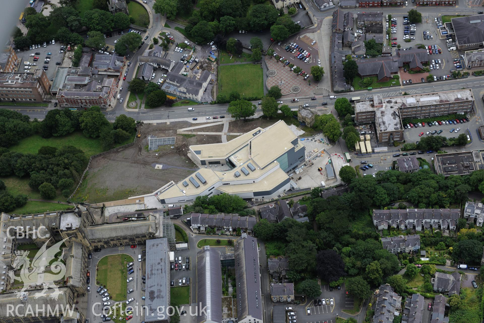 Bangor University, Theatr Gwynedd(demolished),Pontio, medieval church site, town hall, library & war memorial. Oblique aerial photograph taken during the Royal Commission's programme of archaeological aerial reconnaissance by Toby Driver on 30th July 2015.