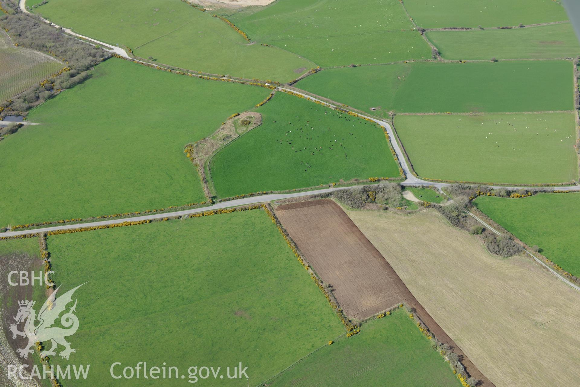 Crugiau Cemmaes Barrow I and II. Oblique aerial photograph taken during the Royal Commission's programme of archaeological aerial reconnaissance by Toby Driver on 15th April 2015.