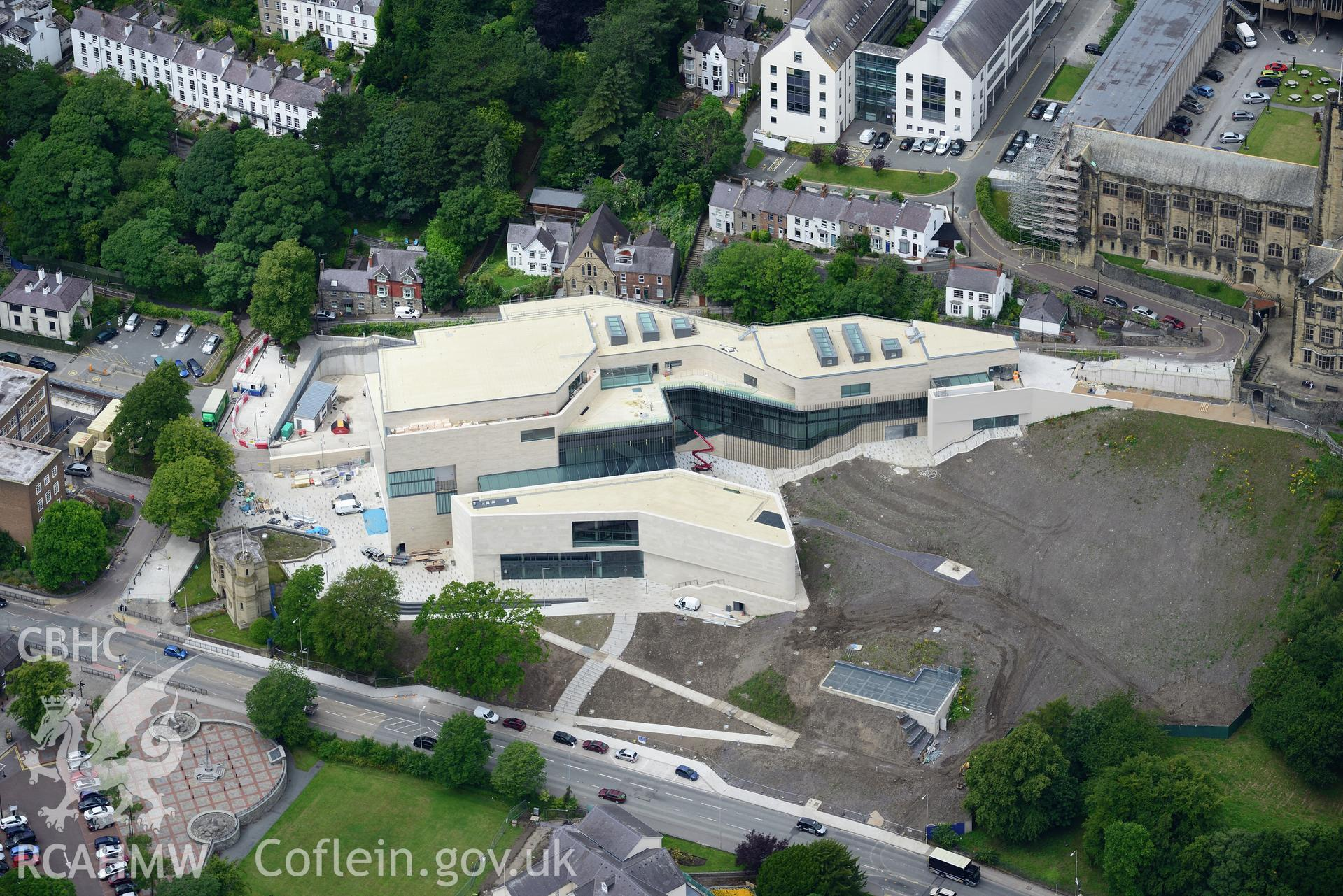 Bangor University, Theatr Gwynedd(demolished),Pontio, town hall, library, medieval church site & war memorial. Oblique aerial photograph taken during the Royal Commission's programme of archaeological aerial reconnaissance by Toby Driver on 30th July 2015.
