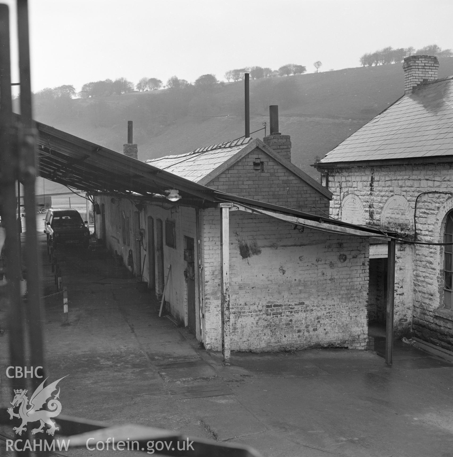Digital copy of an acetate negative showing Blaenserchan Colliery - lamp room with offices from the John Cornwell Collection.