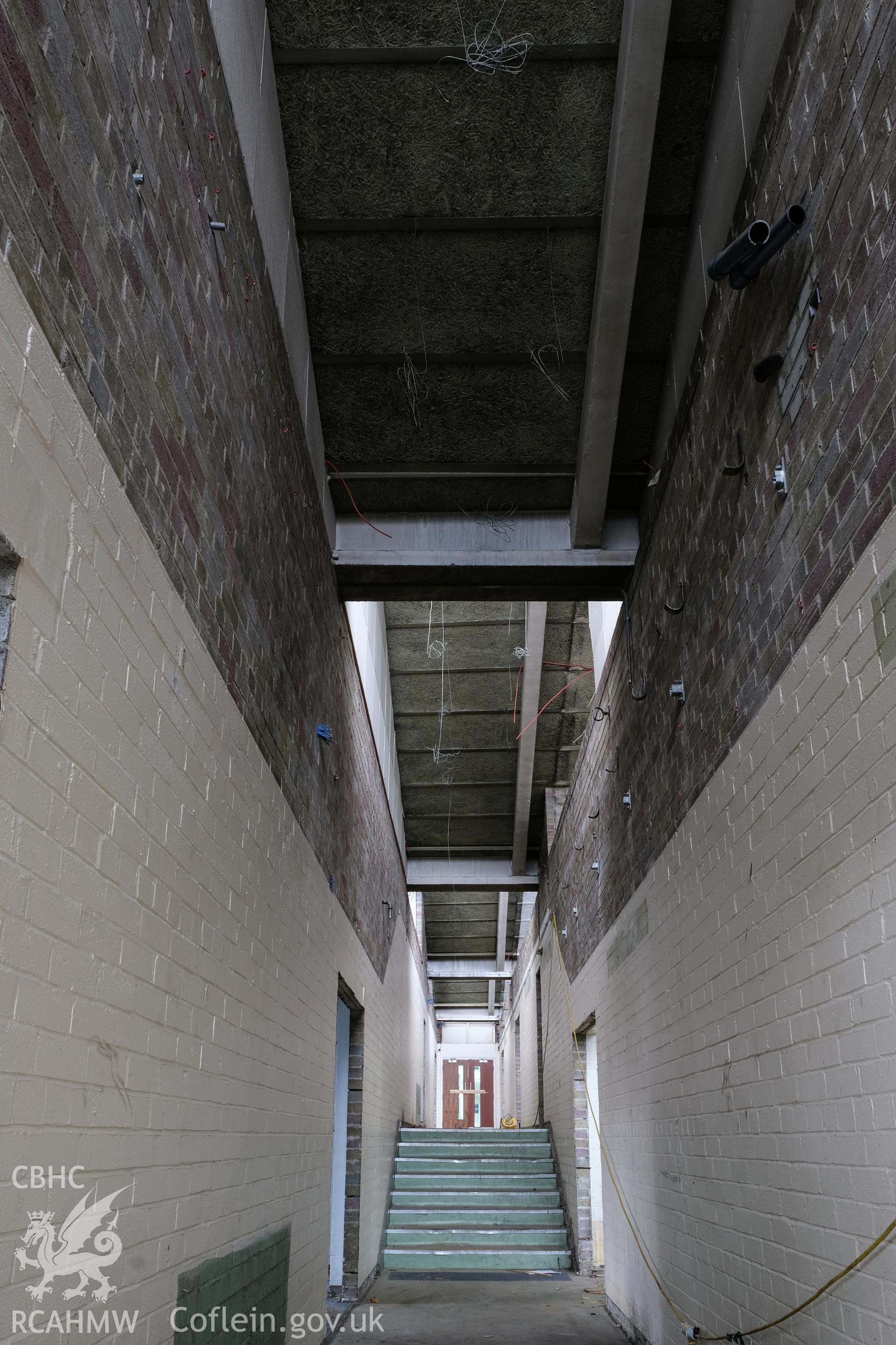 Digital colour photograph showing interior view of corridor at Caernarfonshire Technical College, Ffriddoedd Road, Bangor. Photographed by Dilys Morgan and donated by Wyn Thomas of Grwp Llandrillo-Menai Further Education College, 2019.