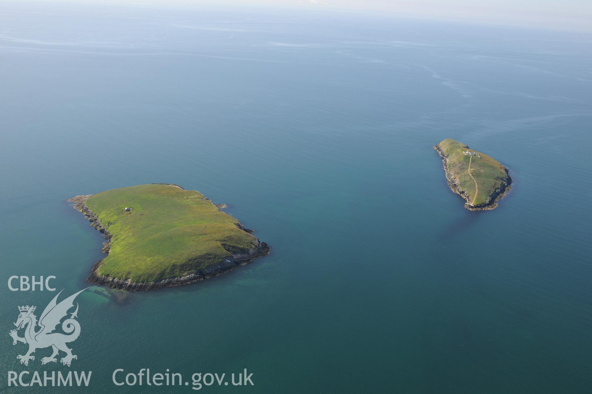 Chapel building on St. Tudwal's Island East, fishtrap off its coast, and lighthouse on St. Tudwal's Island West. Oblique aerial photograph taken during the Royal Commission's programme of archaeological aerial reconnaissance by Toby Driver on 23/06/2015.