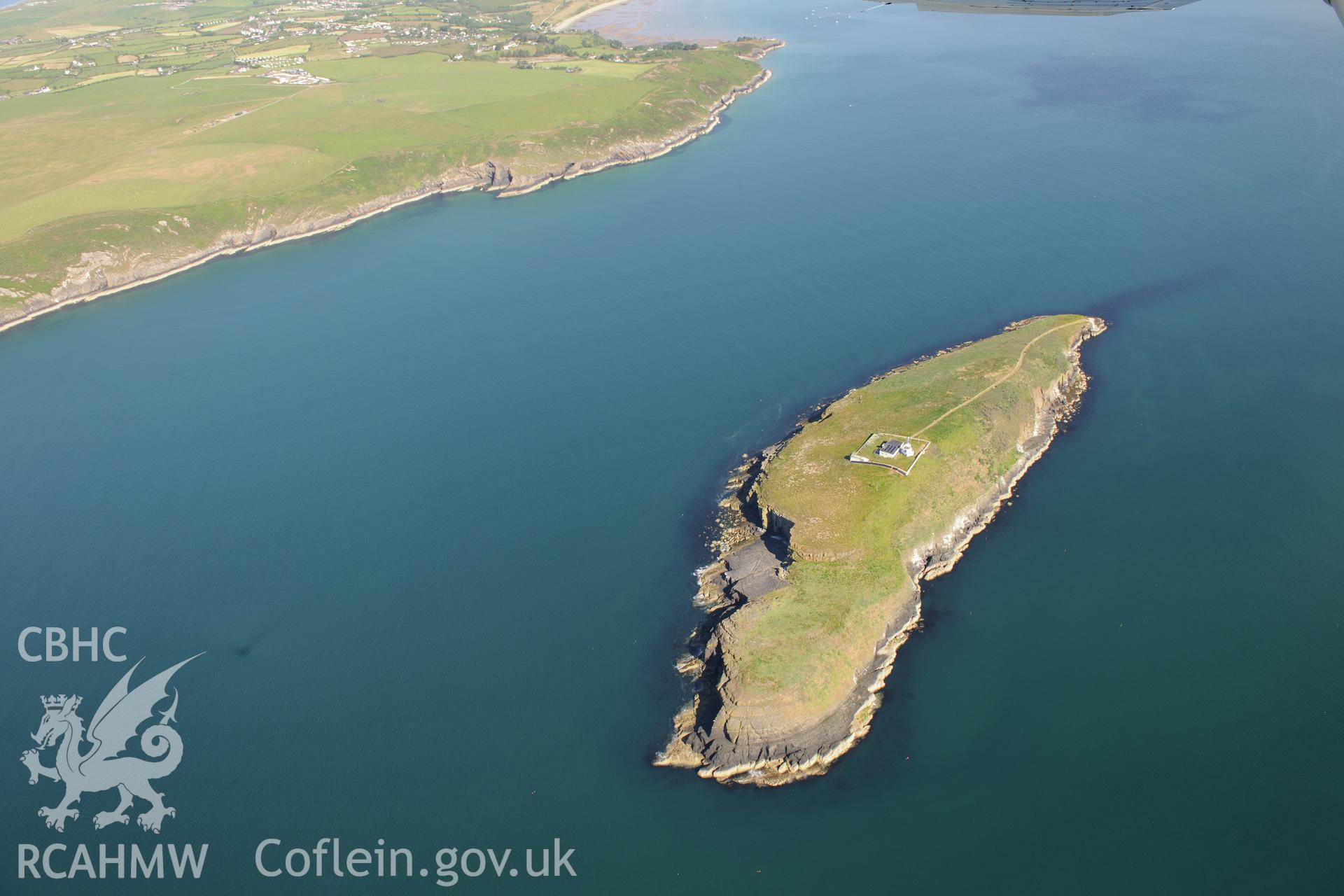 St Tudwal's Island West, its lighthouse and St Tudwal's Sound. Oblique aerial photograph taken during the Royal Commission's programme of archaeological aerial reconnaissance by Toby Driver on 23rd June 2015.