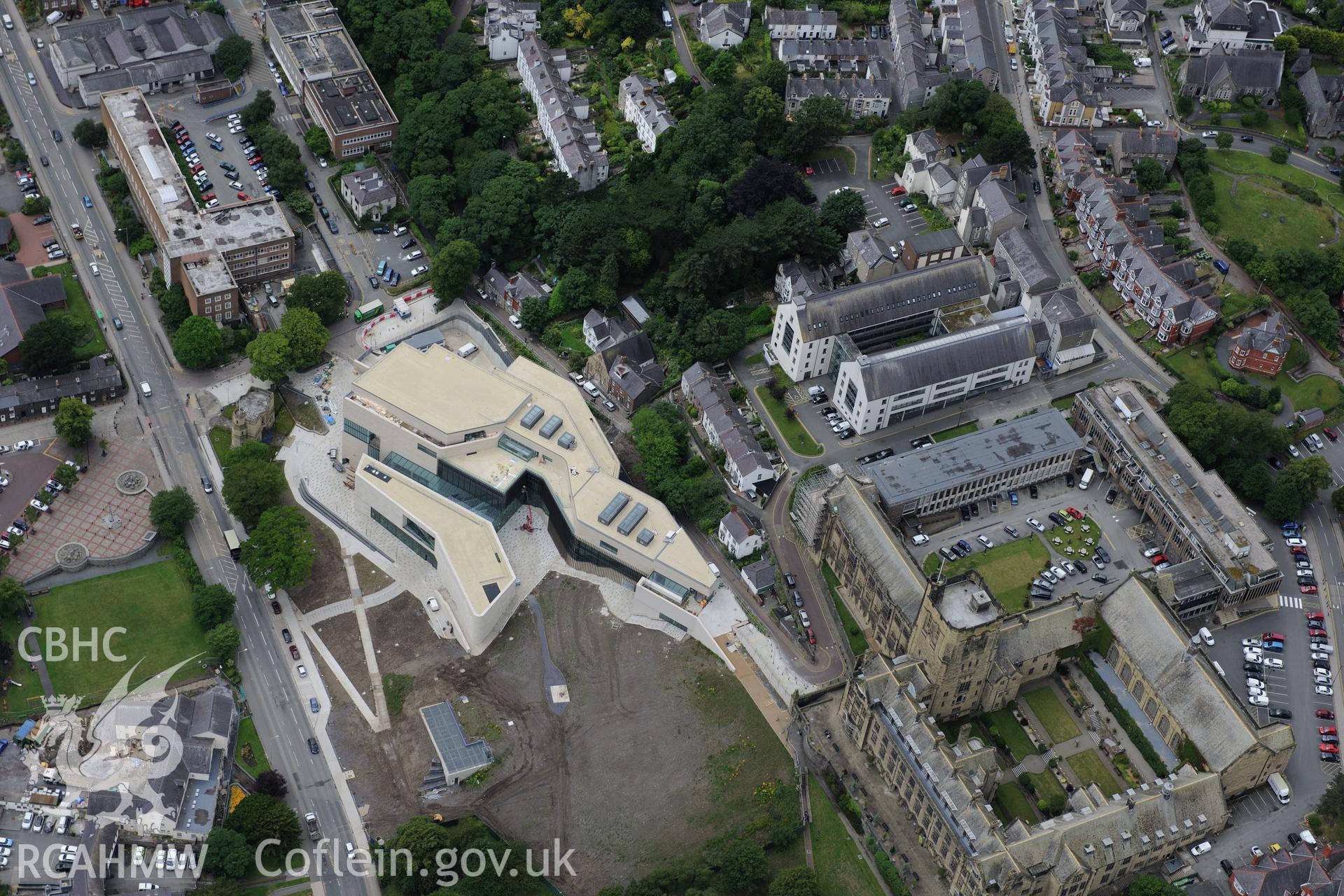 Bangor University, Theatr Gwynedd (demolished), Pontio, War Memorial, Baptist Church & Presbyterian Church. Oblique aerial photograph taken during the Royal Commission's programme of archaeological aerial reconnaissance by Toby Driver on 30th July 2015.
