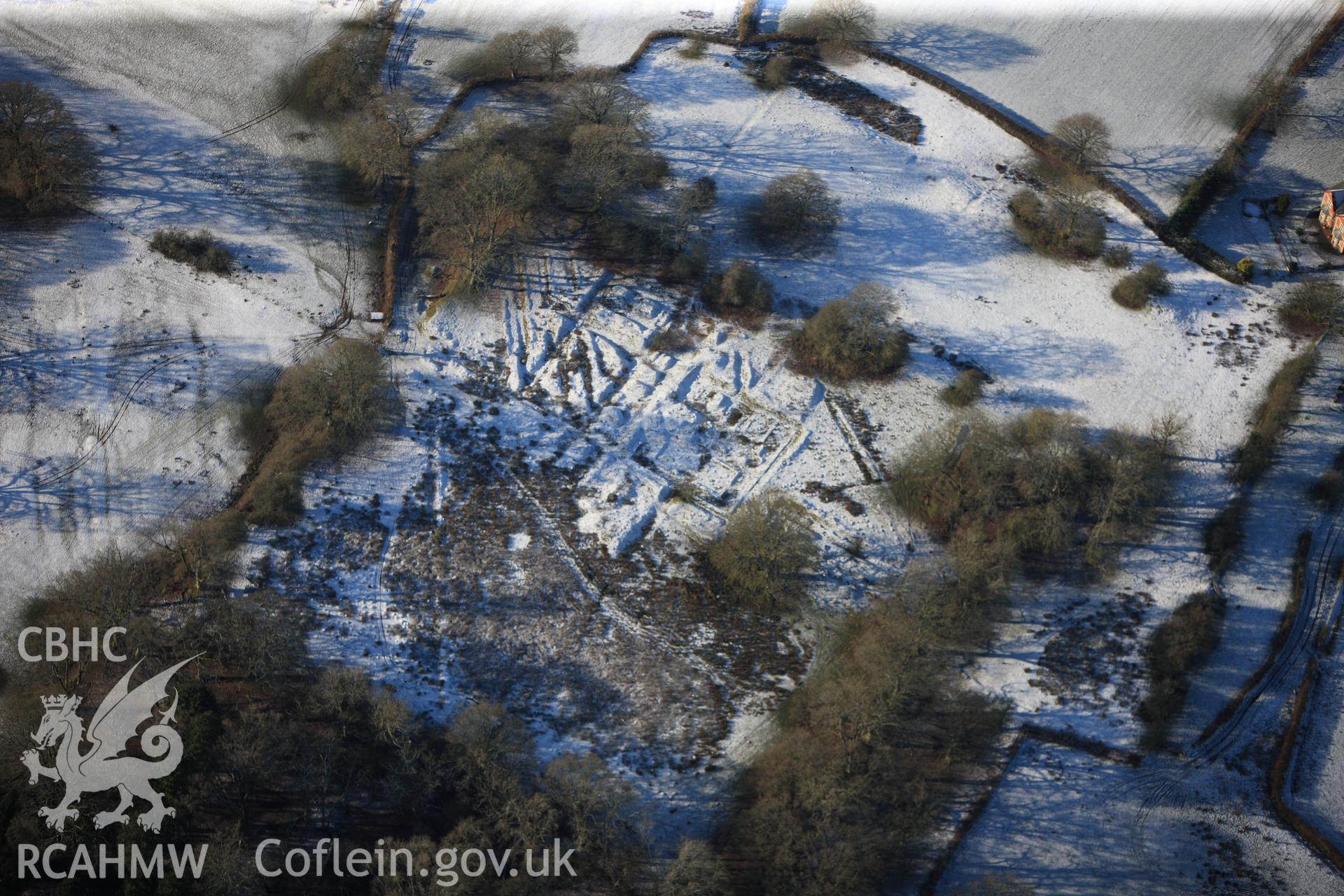 Castell Collen Roman fort, north west of Llandrindod Wells. Oblique aerial photograph taken during the Royal Commission?s programme of archaeological aerial reconnaissance by Toby Driver on 15th January 2013.