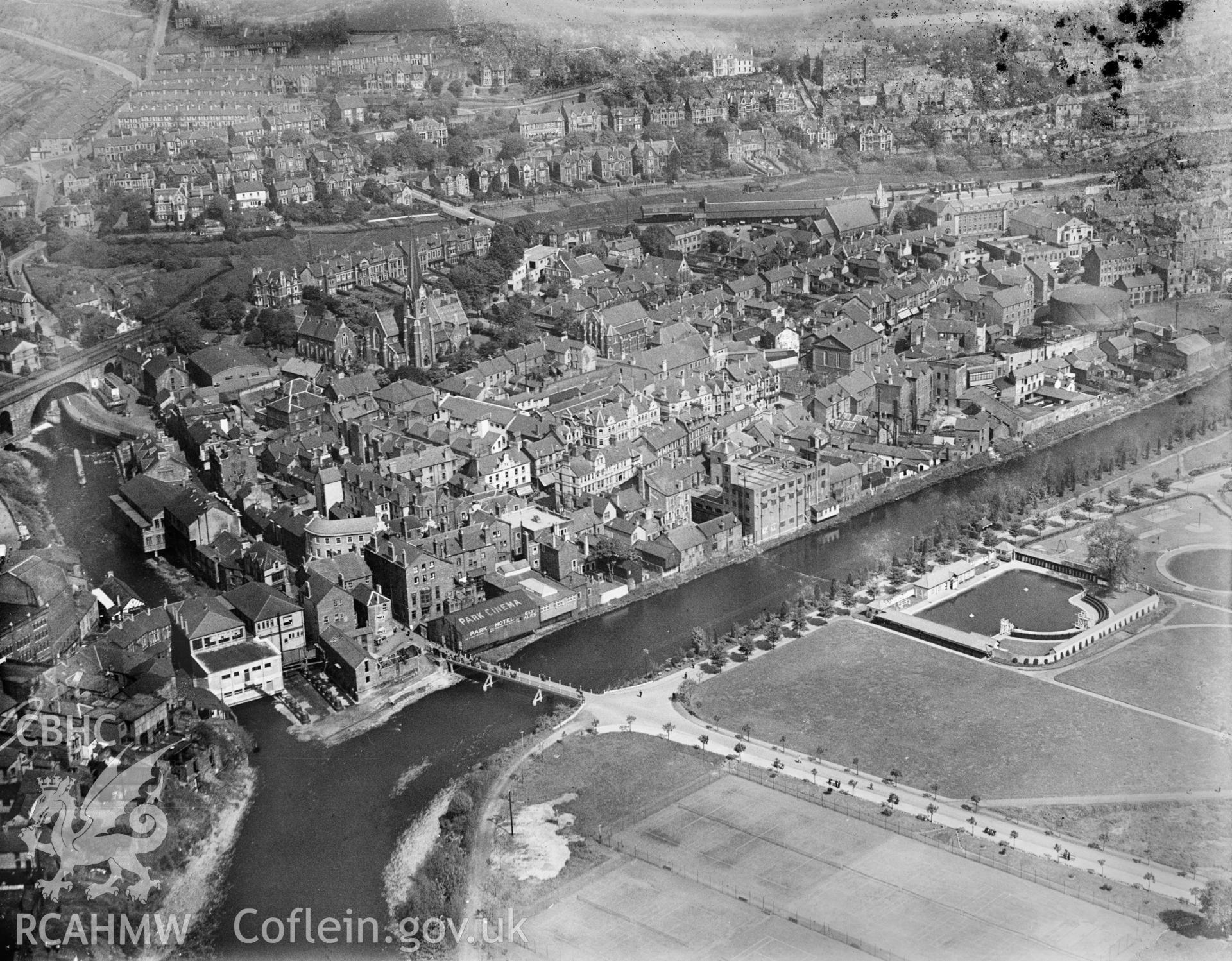 View of Pontypridd showing Ynysangharad Park and swimming pool, oblique aerial view. 5?x4? black and white glass plate negative.