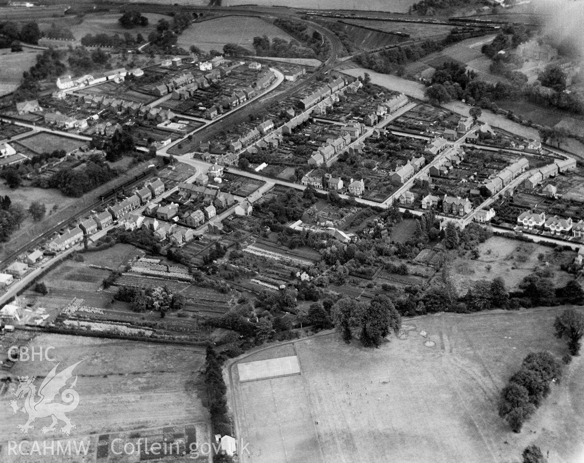 General view of Abergavenny showing the Merthyr, Tredegar & Abergavenny railway line. Oblique aerial photograph, 5?x4? BW glass plate.