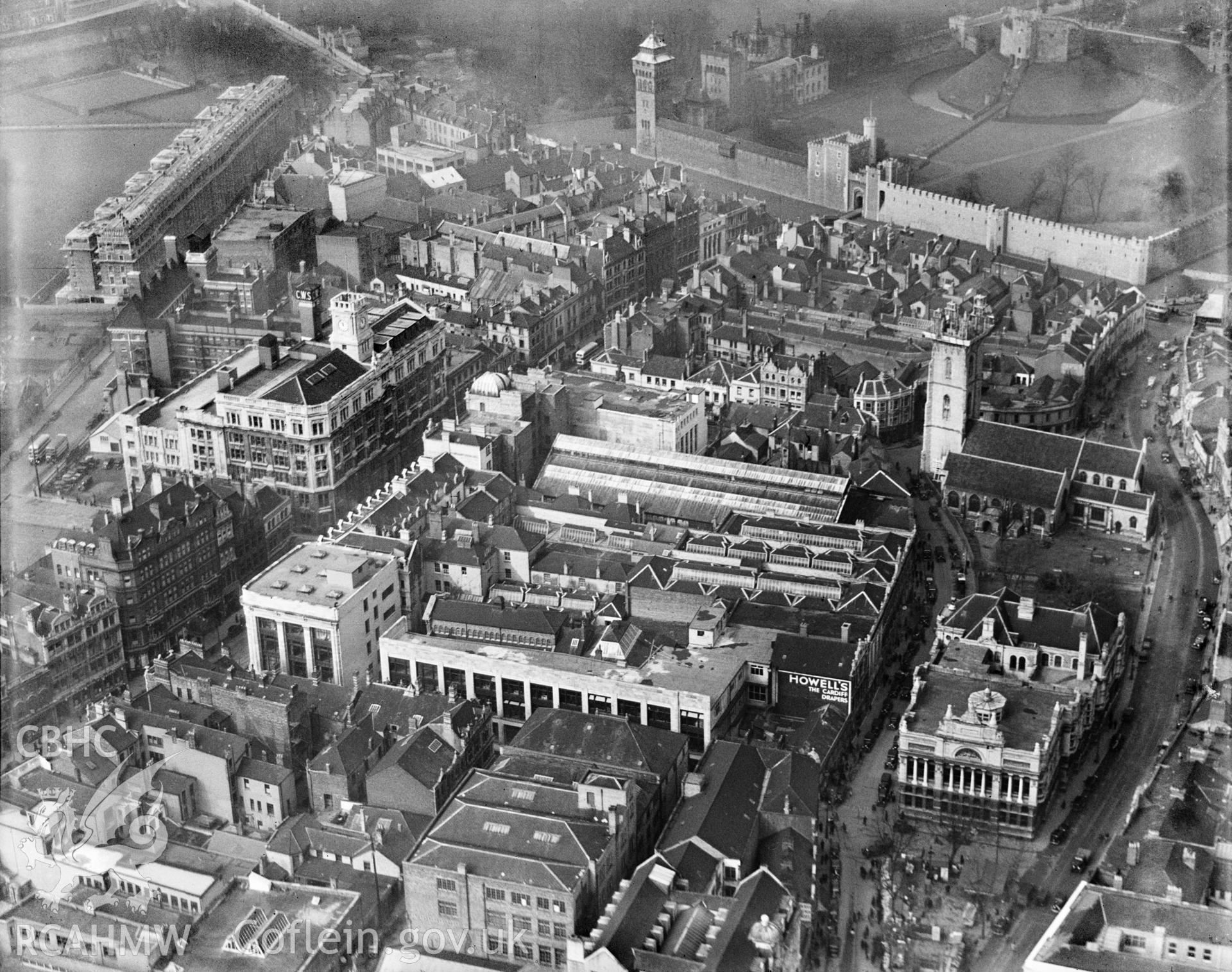 View of central Cardiff, showing James Howell & Co. Ltd. and central library, oblique aerial view. 5?x4? black and white glass plate negative.