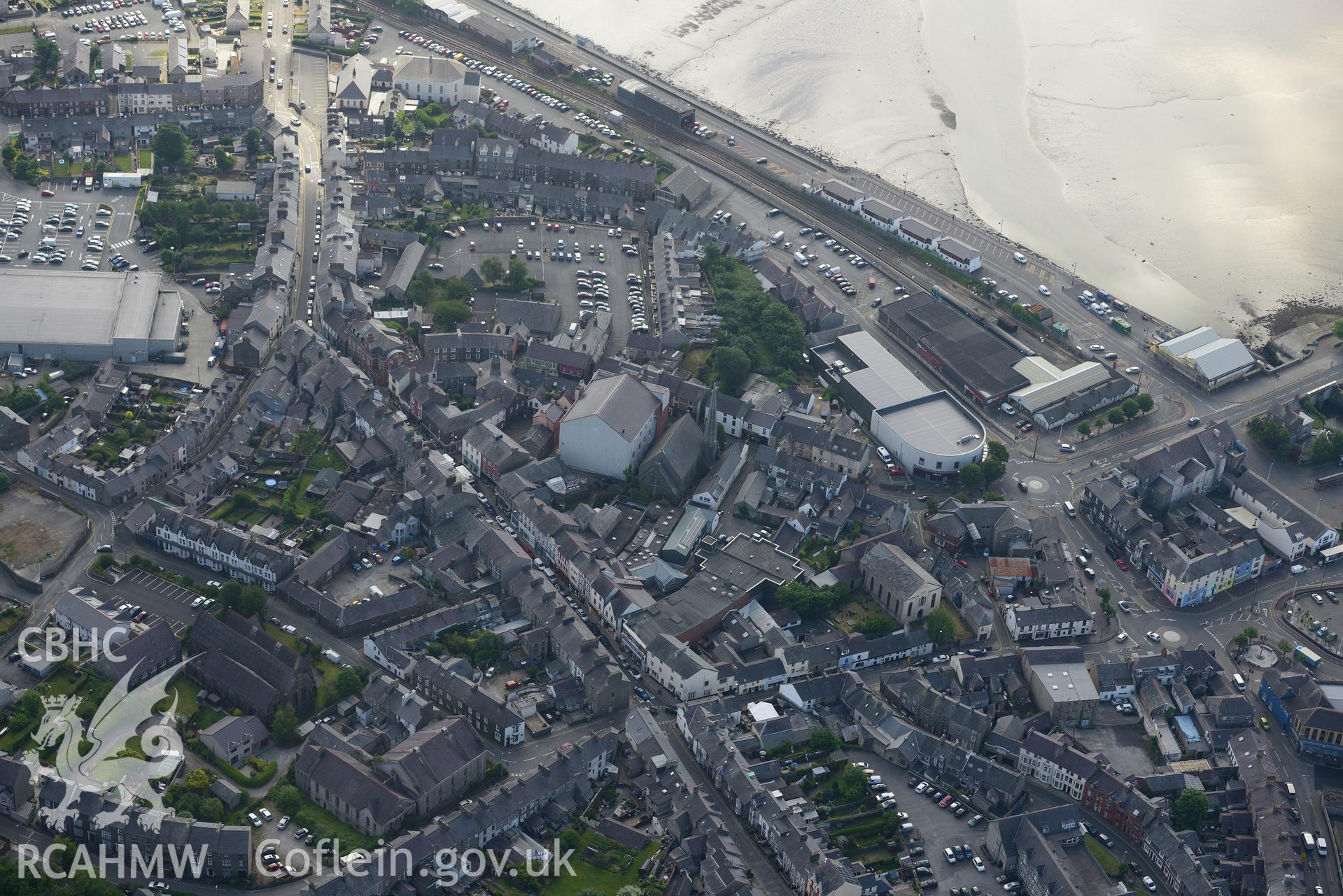 Pen-Lan and Salem chapels; St Peter's Church; old Town Hall; new Town Hall (cinema) & railway station, Pwllheli. Oblique aerial photograph taken during the Royal Commission's programme of archaeological aerial reconnaissance by Toby Driver on 23/06/2015.