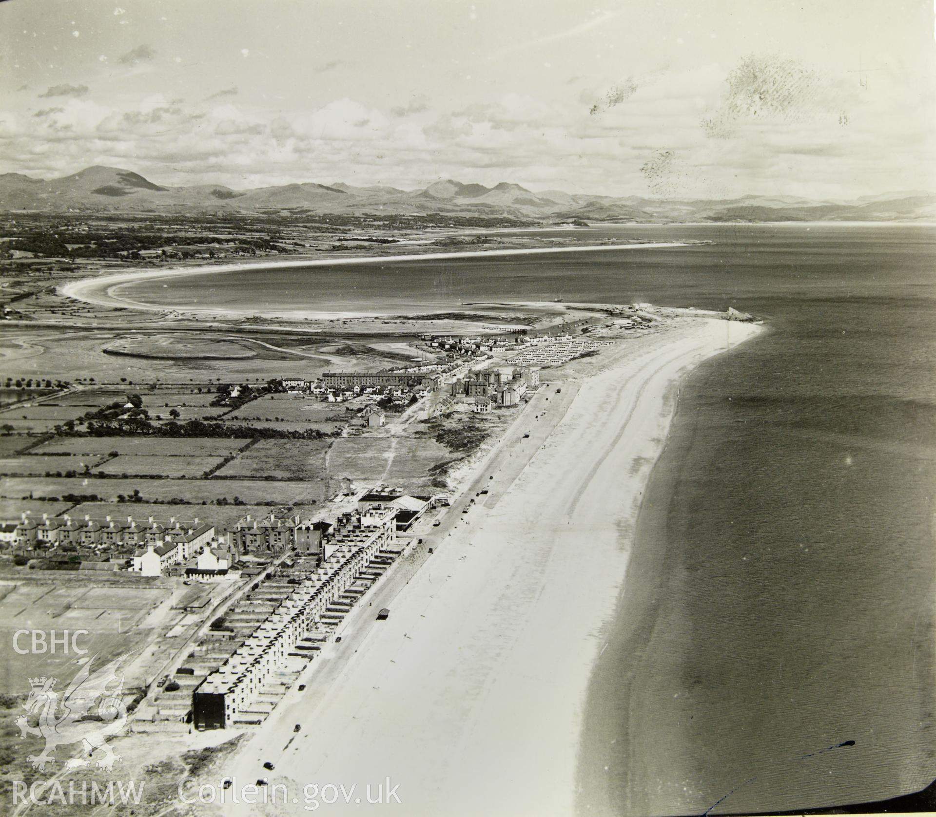 Digital copy of a black and white oblique aerial photograph showing Pwllheli, from Aerofilms album Caernarfonshire (Ll-Z), taken by Aerofilms Ltd and dated 13th June 1950.