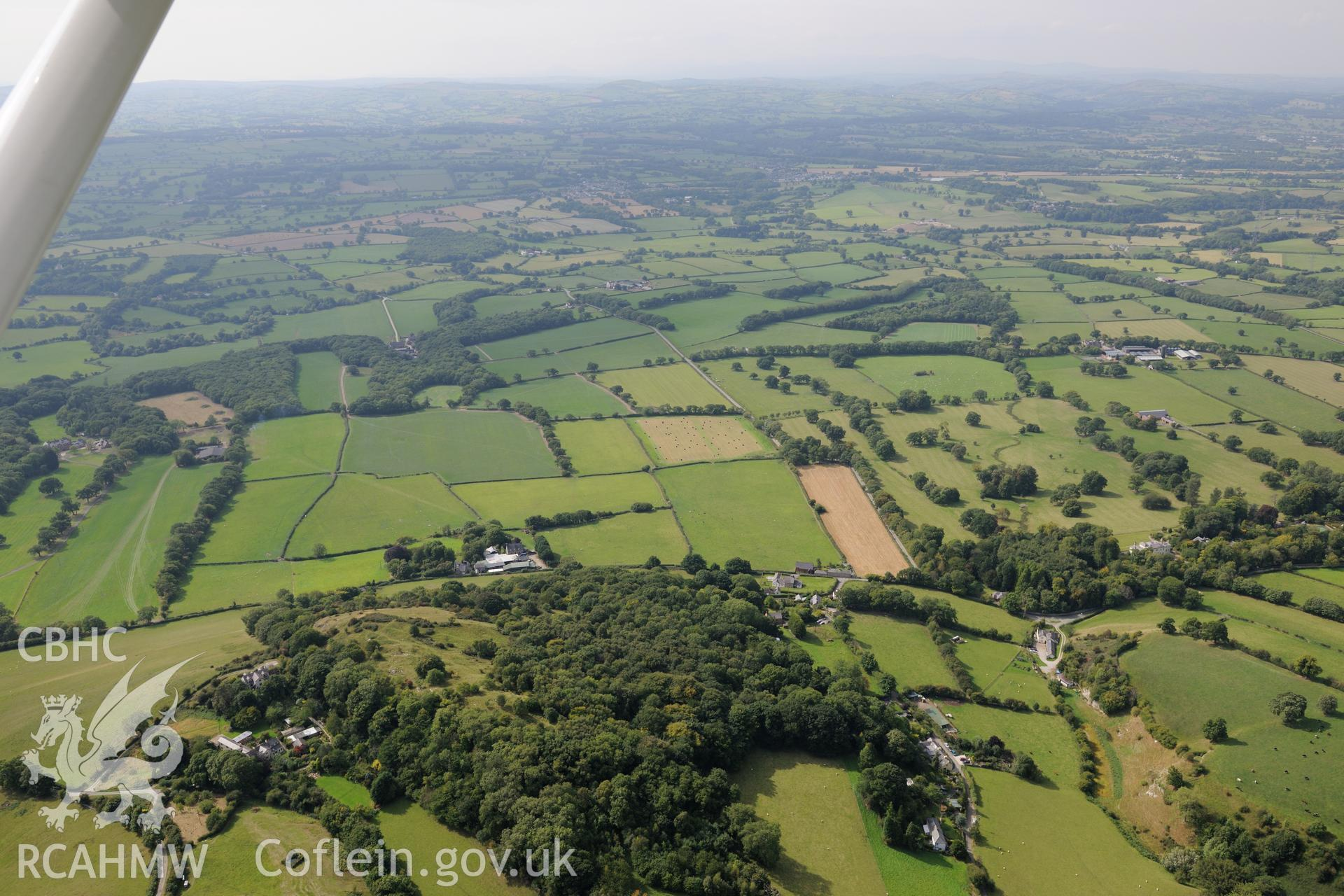 Craig Tremeirchion, including site of Cae-Gwyn cave and Ffynnon Beuno cave. Oblique aerial photograph taken during the Royal Commission's programme of archaeological aerial reconnaissance by Toby Driver on 11th September 2015.