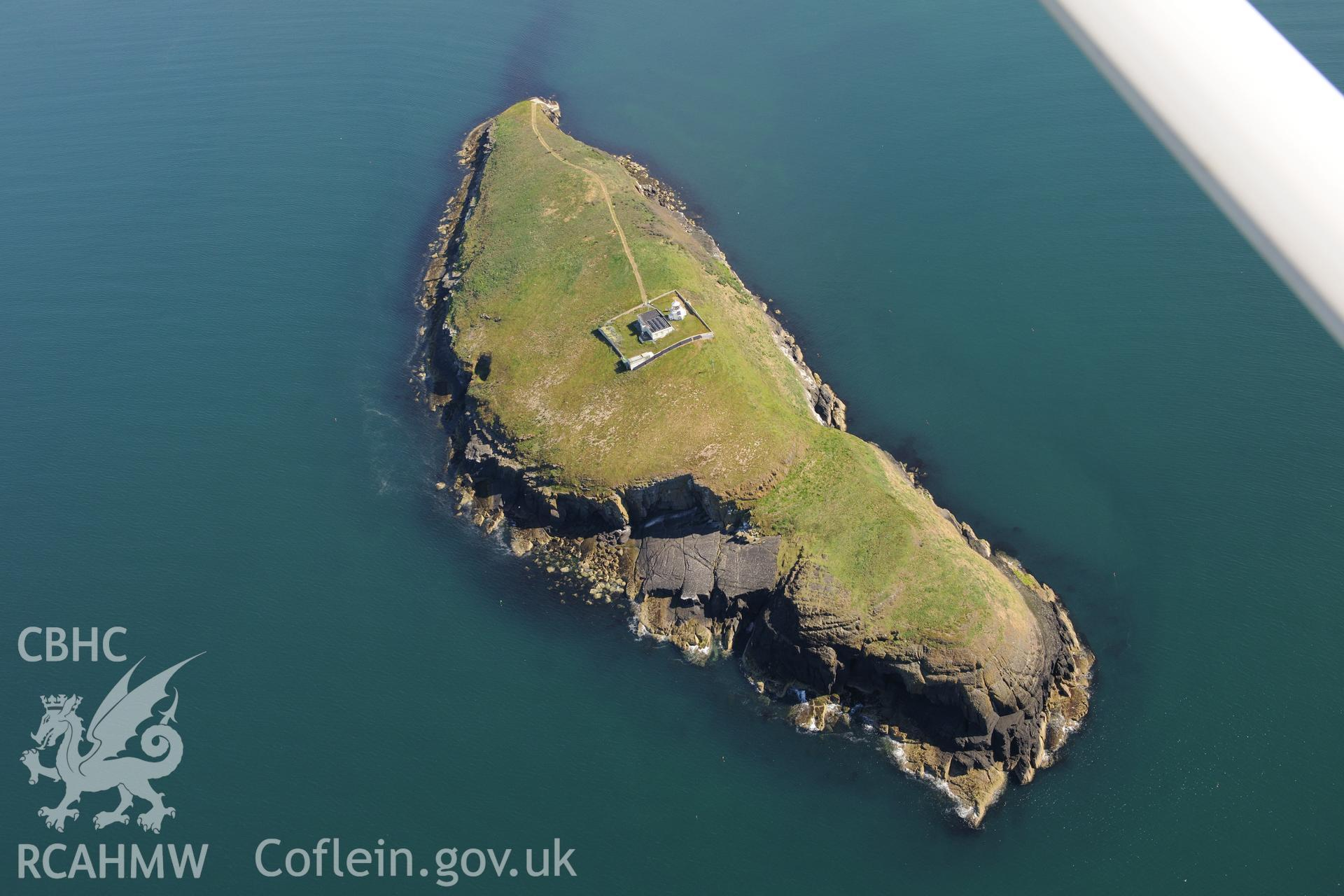 St Tudwal's Island West and its lighthouse. Oblique aerial photograph taken during the Royal Commission's programme of archaeological aerial reconnaissance by Toby Driver on 23rd June 2015.