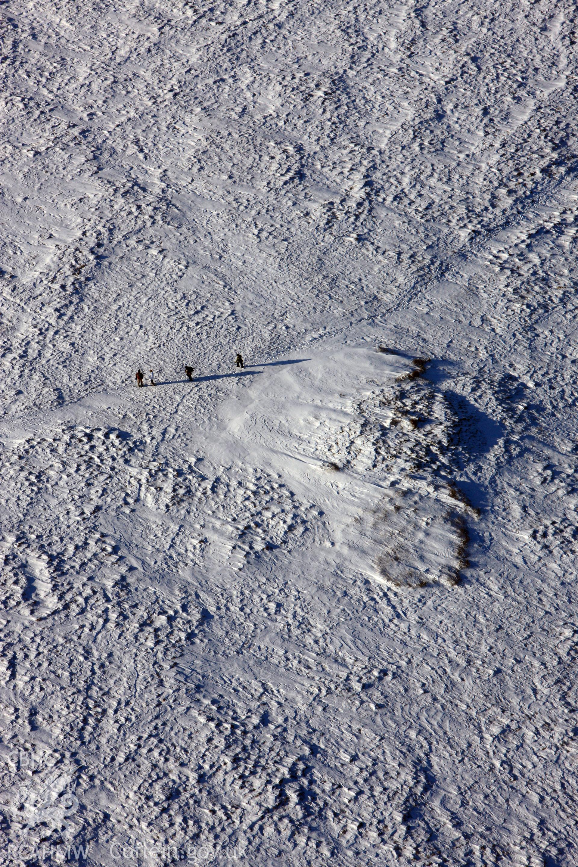 RCAHMW colour oblique aerial photograph of Foel Cwmcerwyn cairn under snow, by Toby Driver, 01/12/2010.
