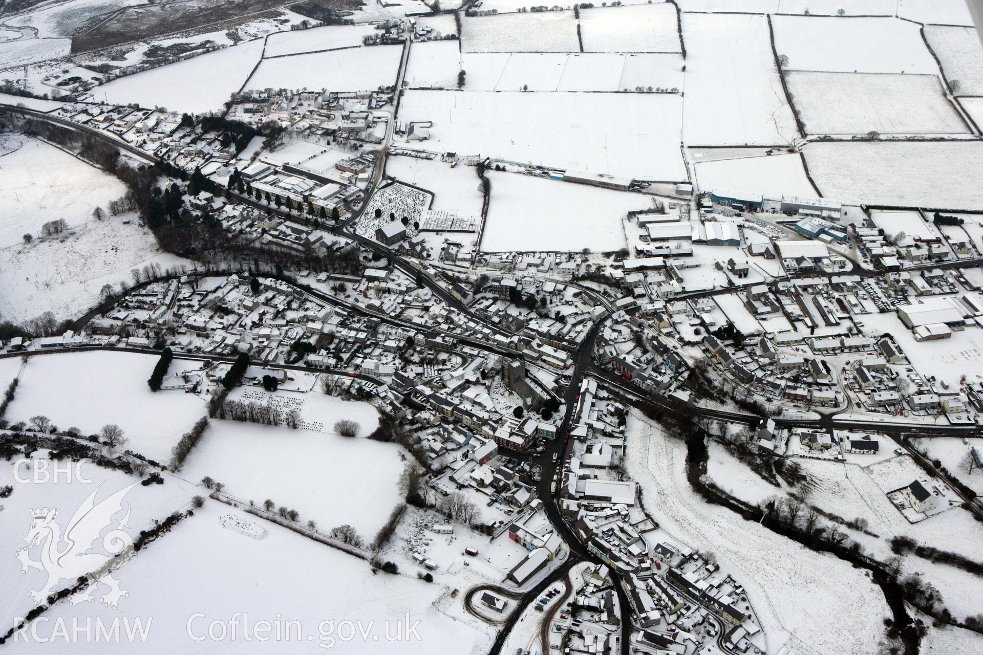 RCAHMW colour oblique aerial photograph of Tregaron under snow, by Toby Driver, 02/12/2010.