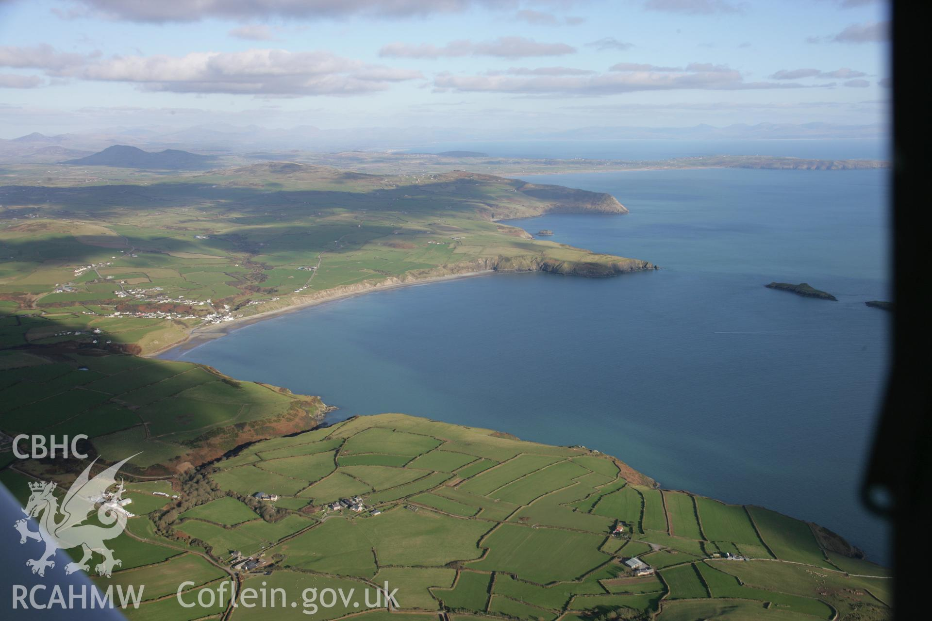 RCAHMW colour oblique aerial photograph of Aberdaron and the landscape from the west. Taken on 09 February 2006 by Toby Driver.