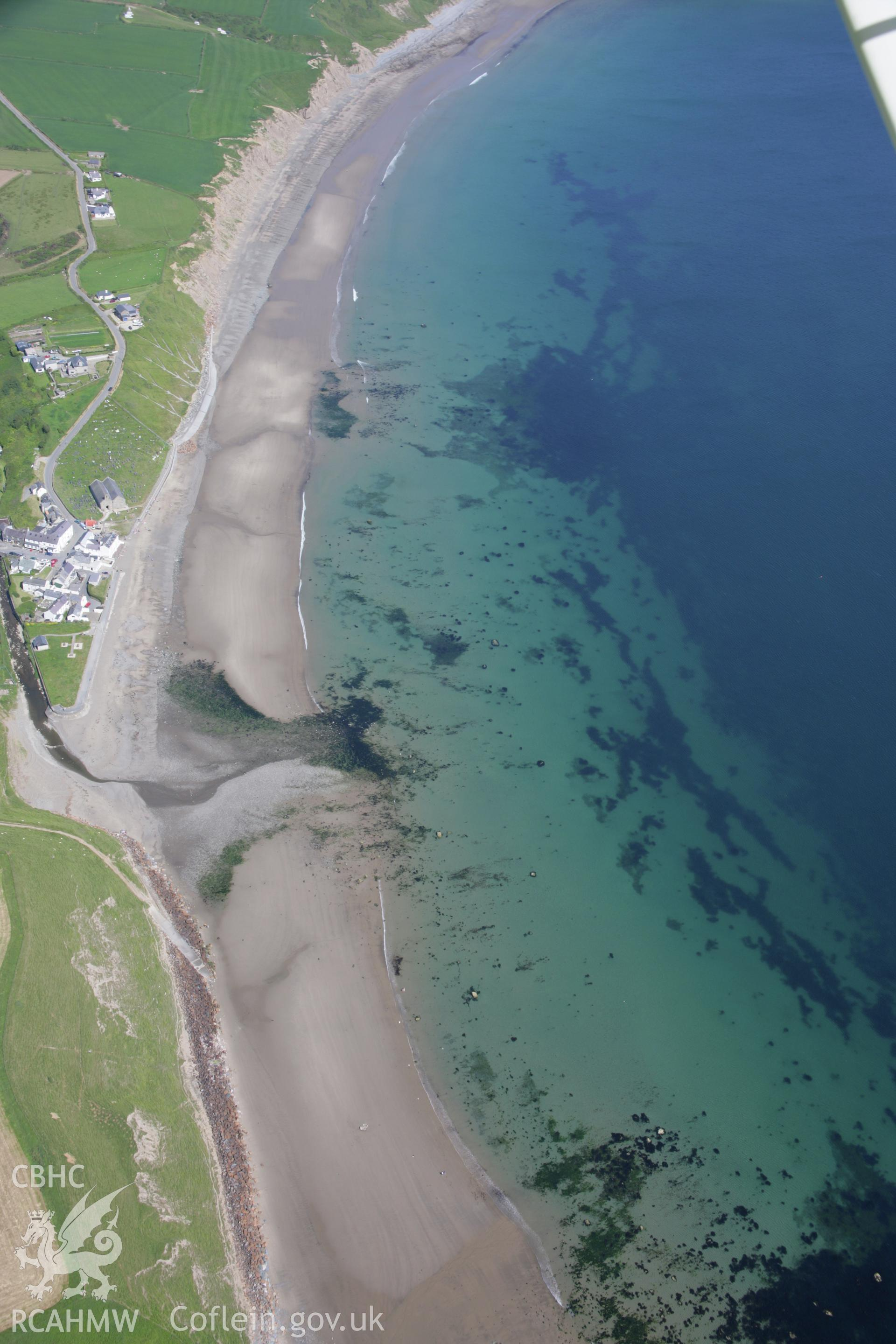 RCAHMW colour oblique aerial photograph of Aberdaron with the seafront from the west. Taken on 14 June 2006 by Toby Driver.