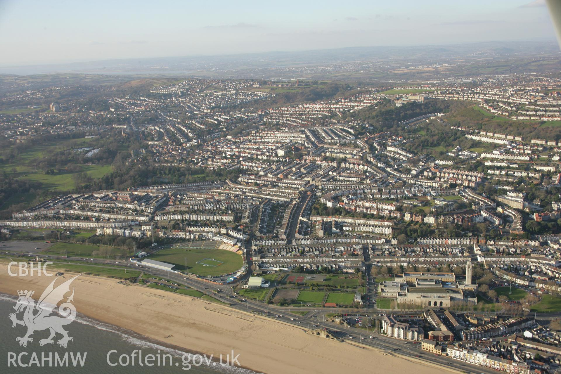 RCAHMW colour oblique aerial photograph of Guildhall, Swansea from the south-east. A wide view with the Uplands area beyond. Taken on 26 January 2006 by Toby Driver.