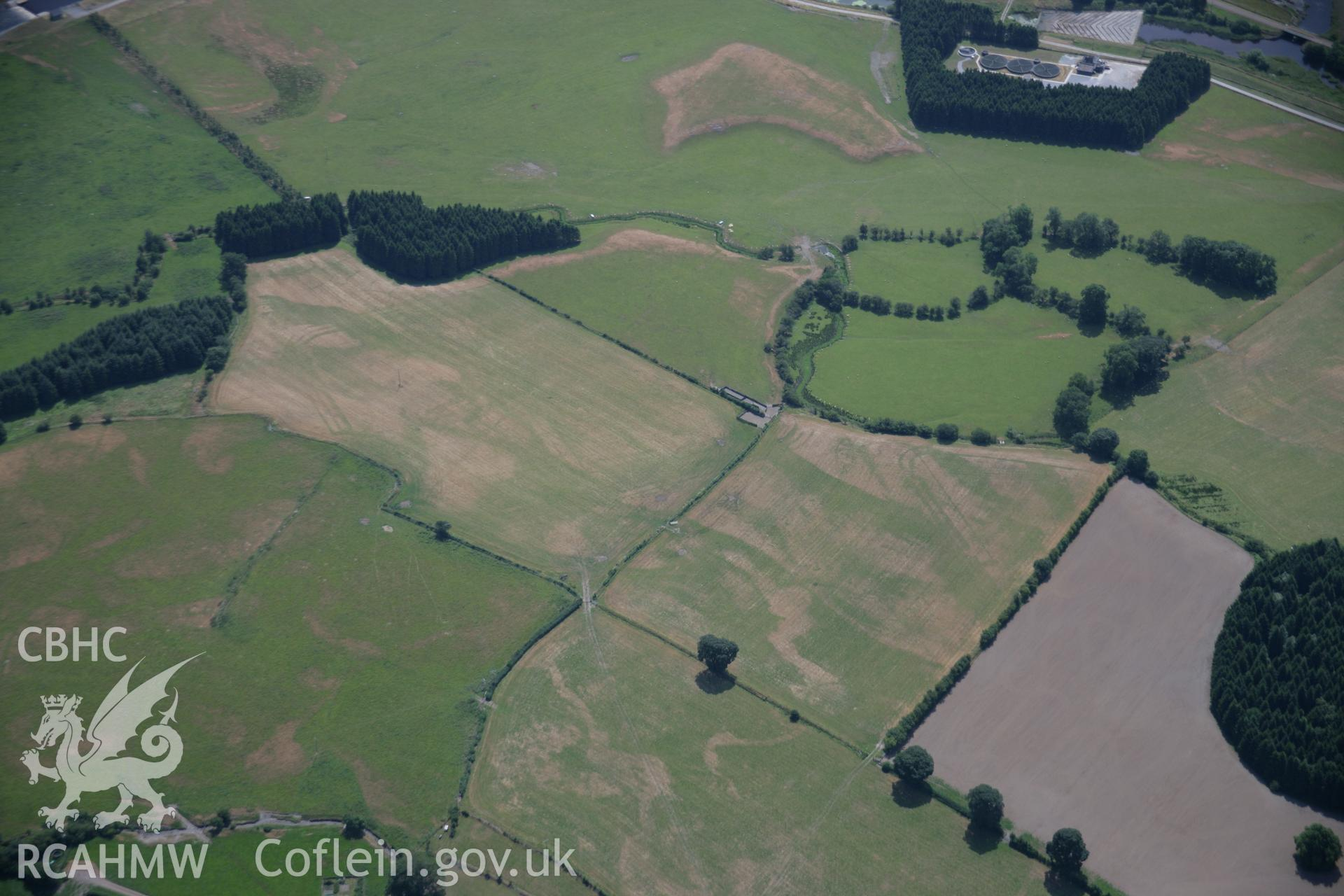 RCAHMW colour oblique aerial photograph of Llanfor Roman Fort. Taken on 25 July 2006 by Toby Driver.