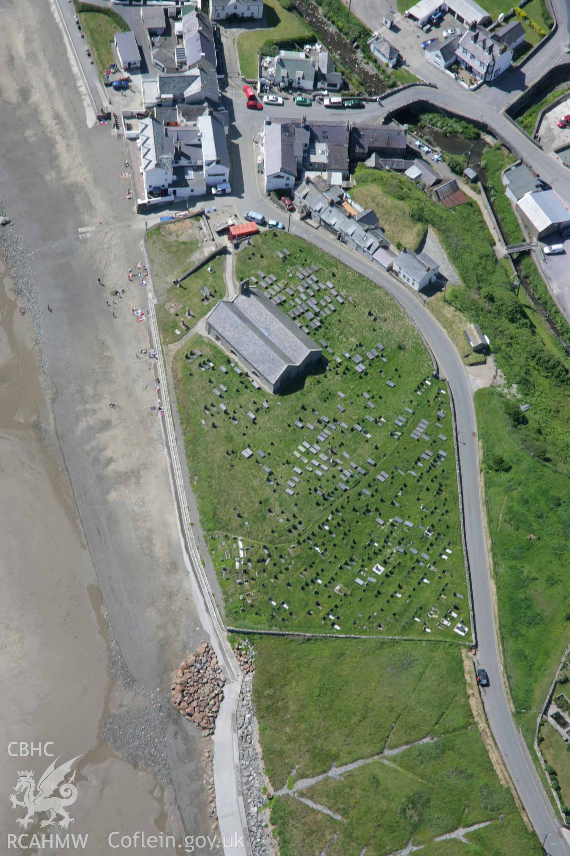 RCAHMW colour oblique aerial photograph of St Hywyns Church, Aberdaron, from the east. Taken on 14 June 2006 by Toby Driver.