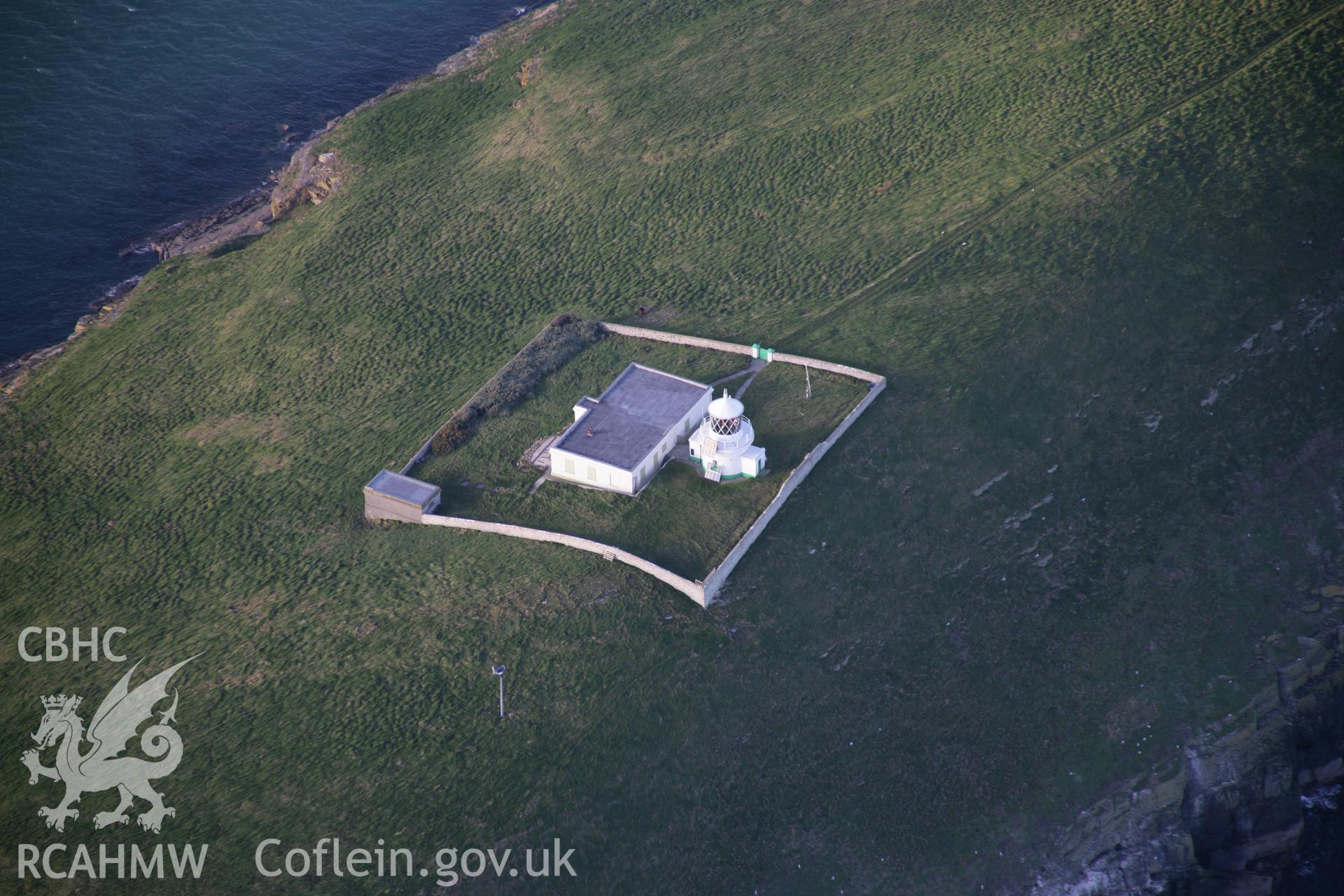 RCAHMW colour oblique aerial photograph of St Tudwall's Lighthouse from the south-east. Taken on 09 February 2006 by Toby Driver.