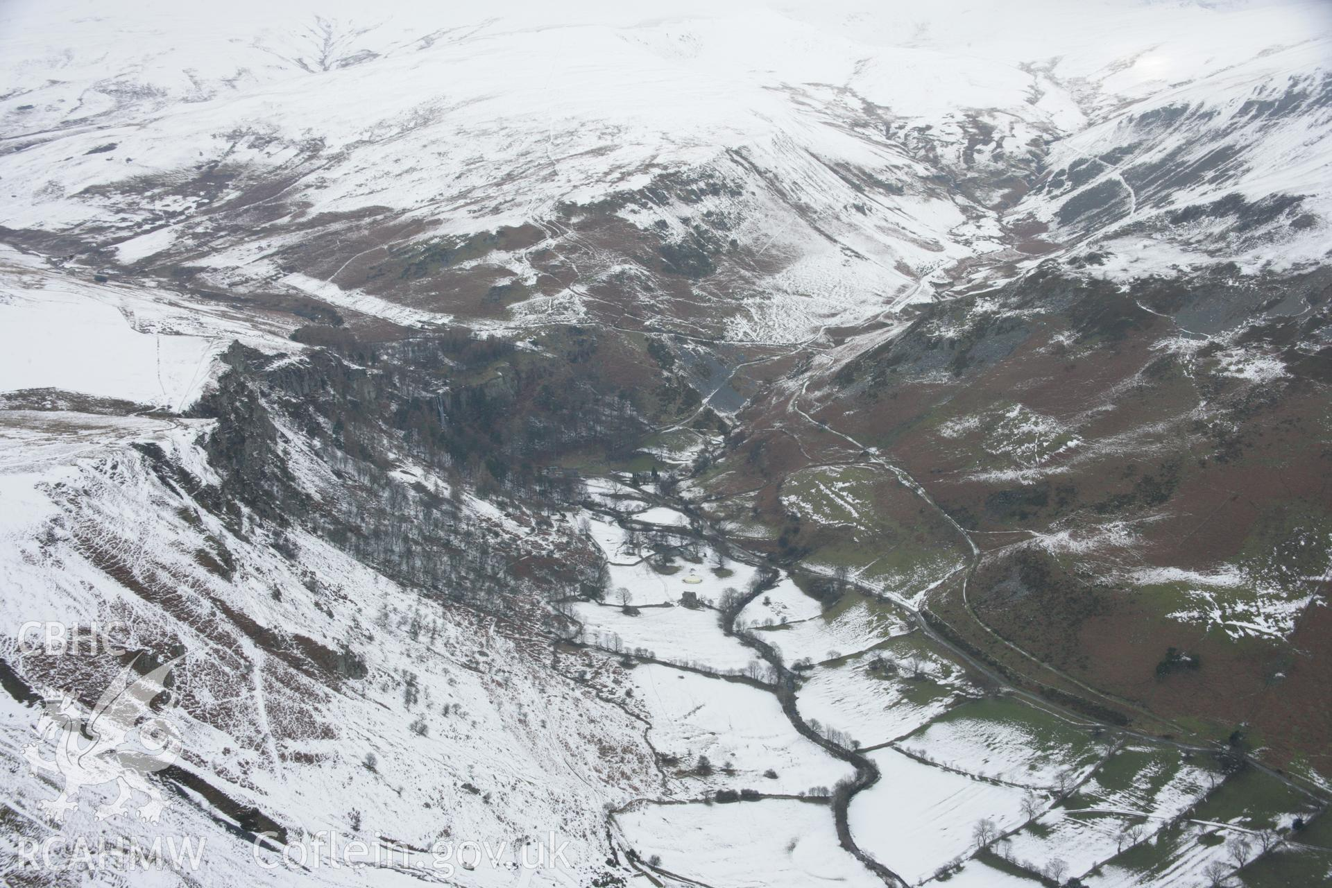 RCAHMW colour oblique aerial photograph of Cwm Blowty and Pistyll Rhaeadr Waterfall and Walks, under snow in a landscape view from the south-east. Taken on 06 March 2006 by Toby Driver.