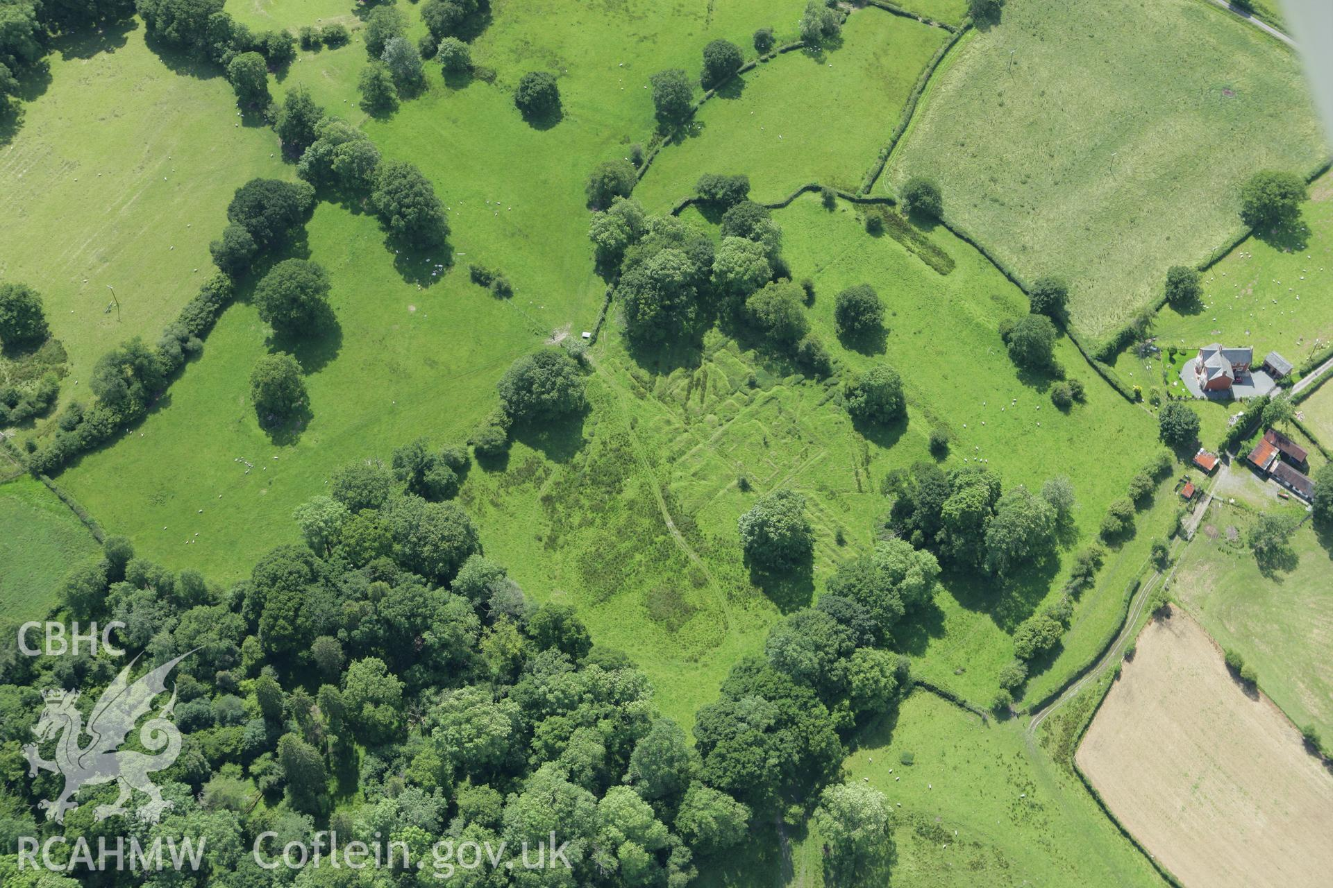 RCAHMW colour oblique aerial photograph of Castell Collen Roman Fort. Taken on 09 July 2007 by Toby Driver