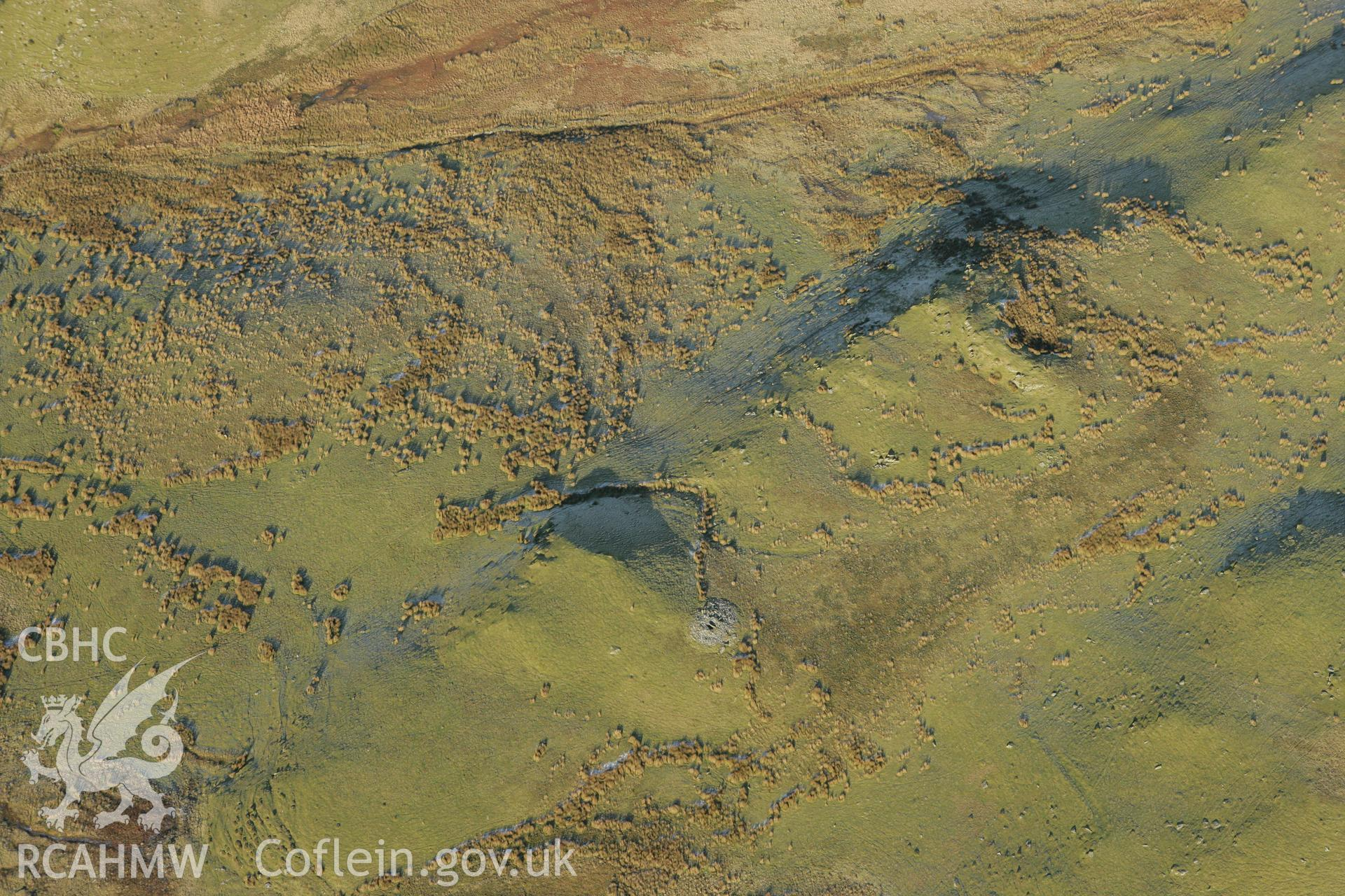 RCAHMW colour oblique photograph of Blaen Glasffrwd cairn III. Taken by Toby Driver on 20/12/2007.