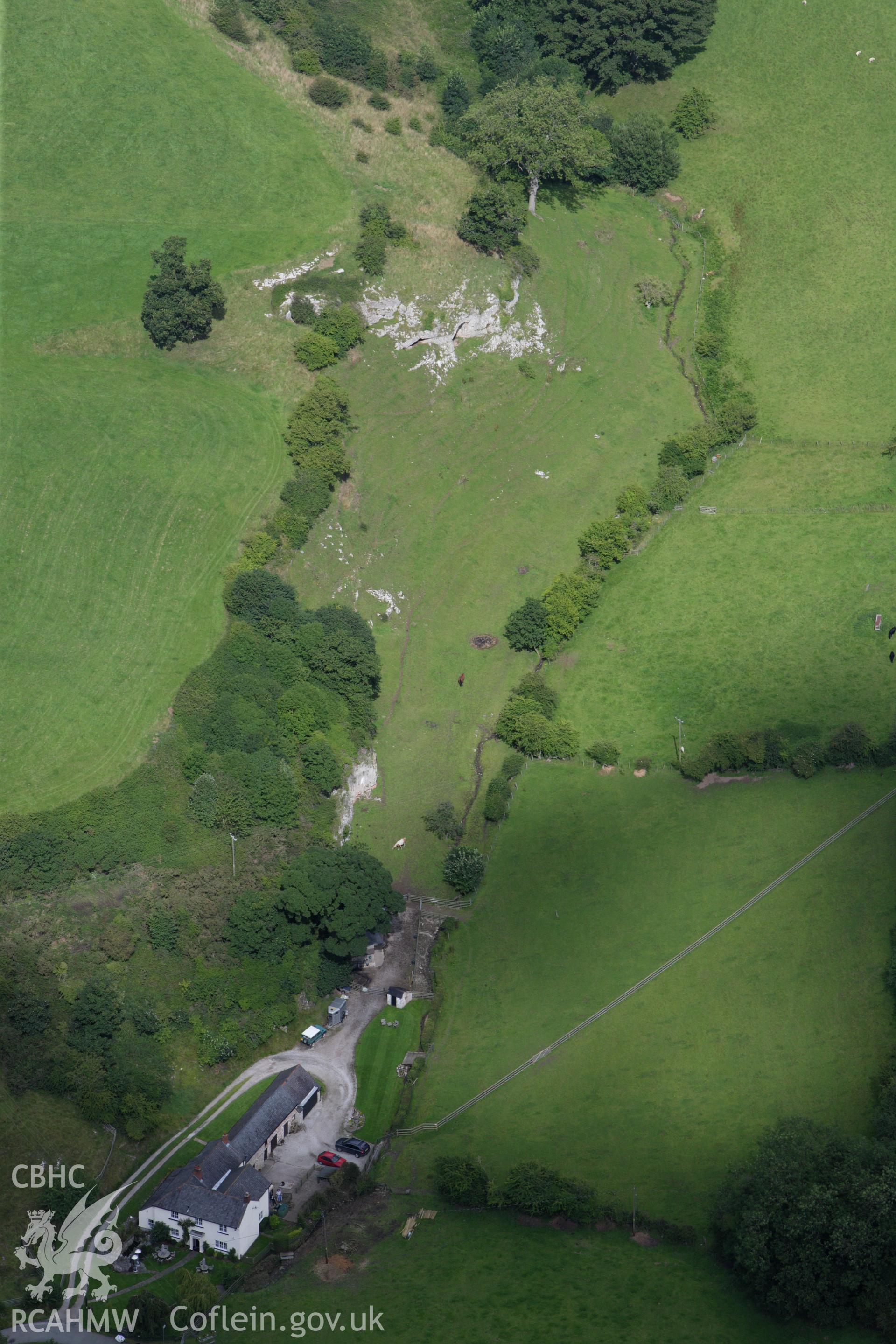 RCAHMW colour oblique aerial photograph of Ffynnon Beuno Cave. Taken on 30 July 2009 by Toby Driver