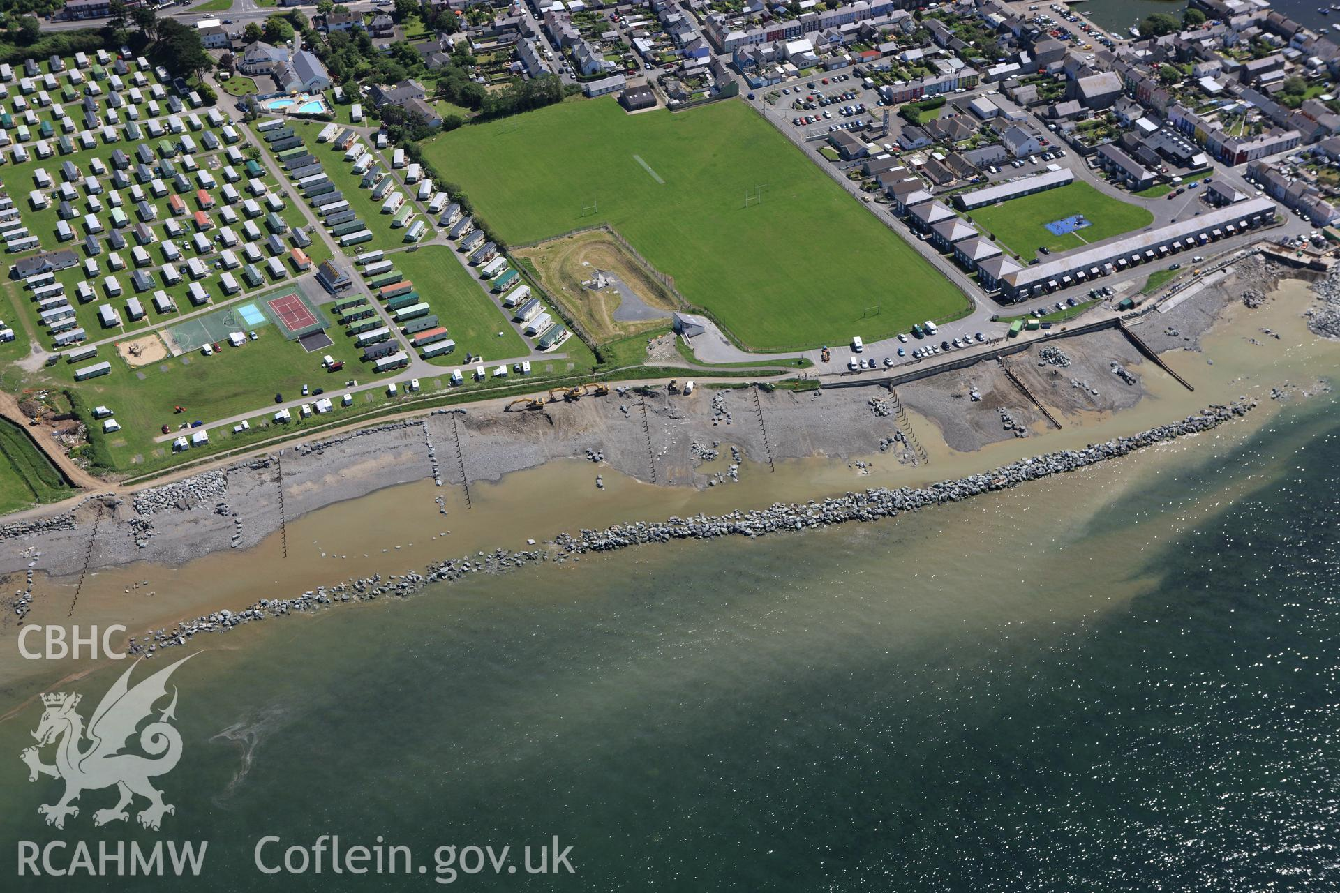 RCAHMW colour oblique aerial photograph of Aberaeron with coastal defence work ongoing. Taken on 01 June 2009 by Toby Driver